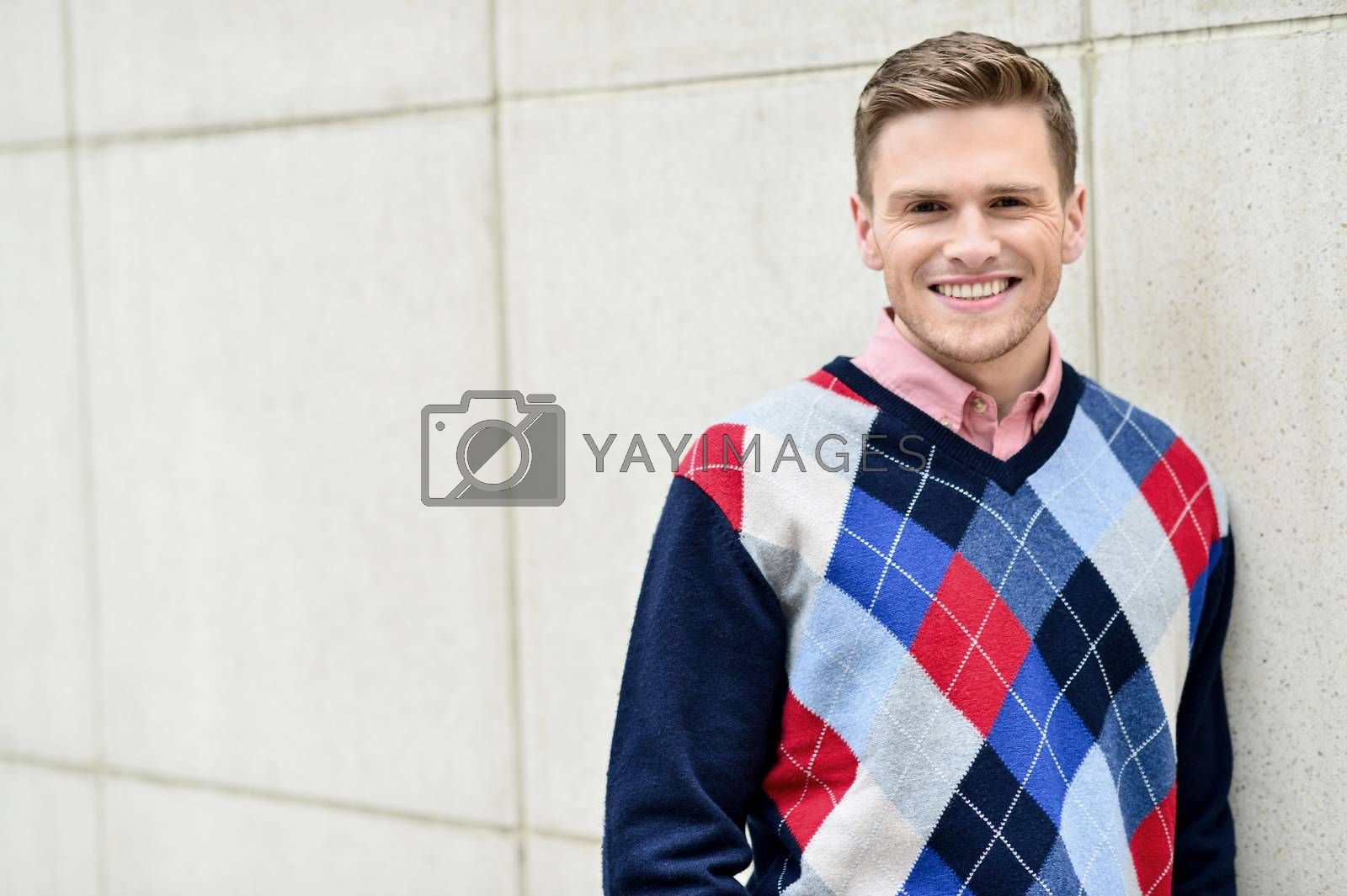 Royalty free image of Young man leaning relaxed against the wall by stockyimages