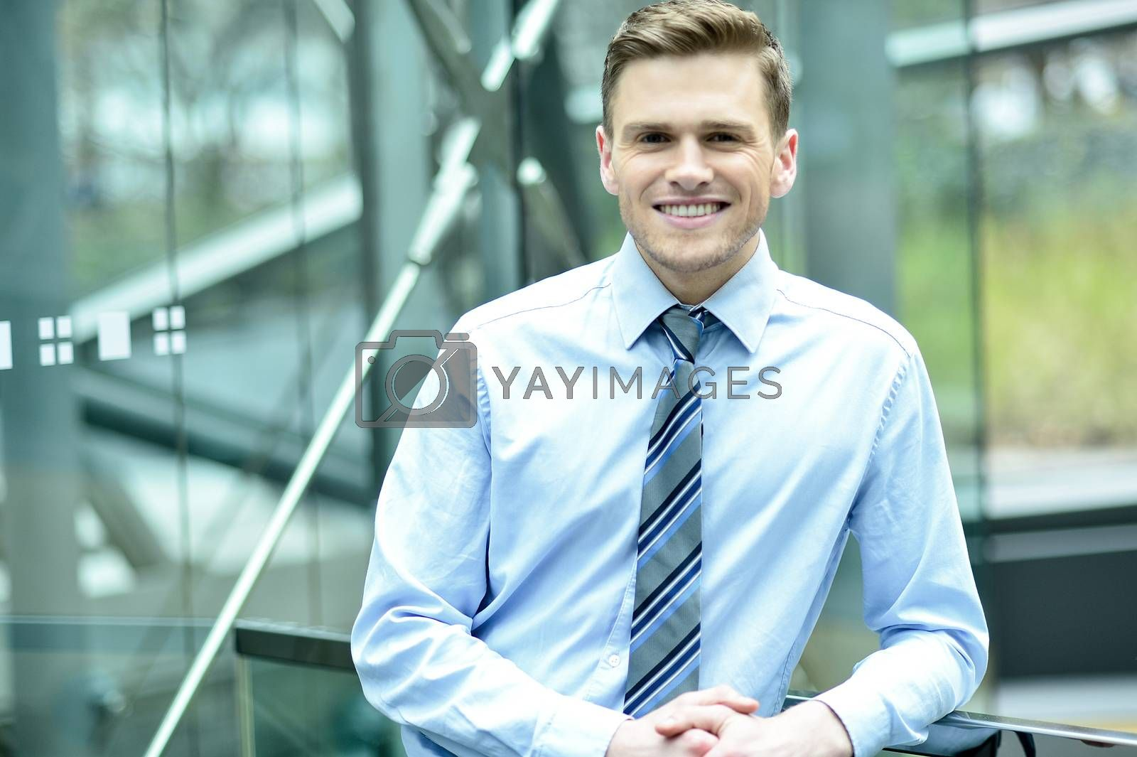 Royalty free image of Young businessman casual poses at outdoor by stockyimages