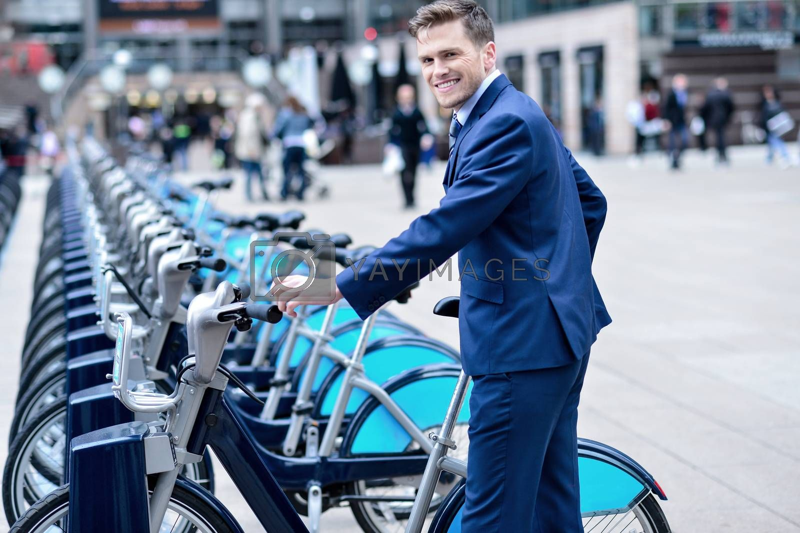 Royalty free image of Young businessman with a bicycle by stockyimages