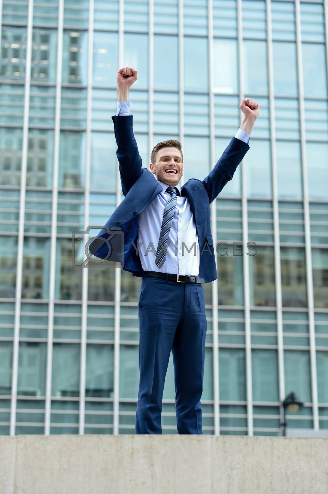 Royalty free image of Excited businessman raising his arms by stockyimages