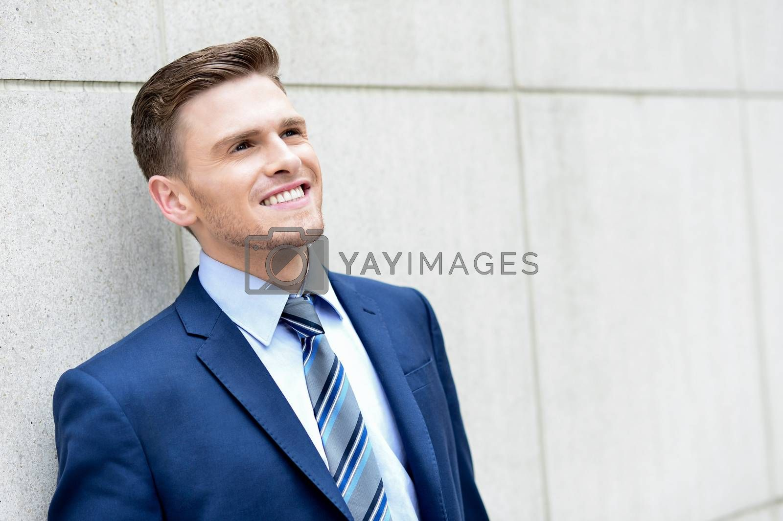 Royalty free image of Young business man posing outdoor by stockyimages