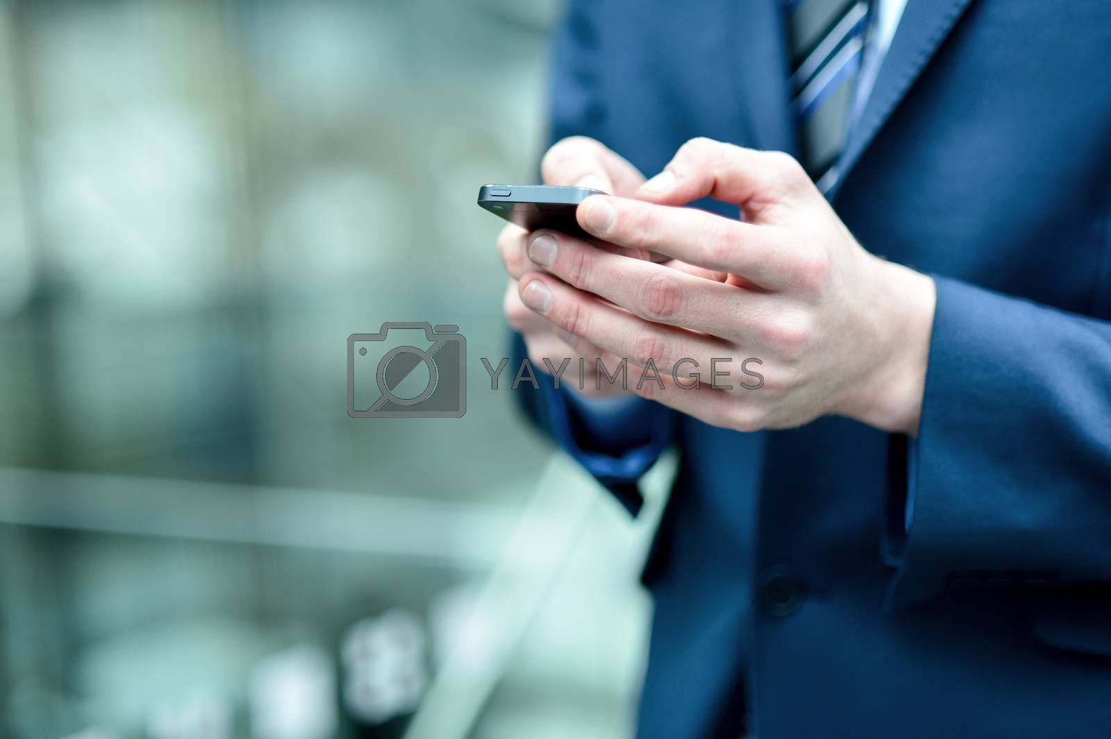 Royalty free image of Close up of a man using mobile phone by stockyimages