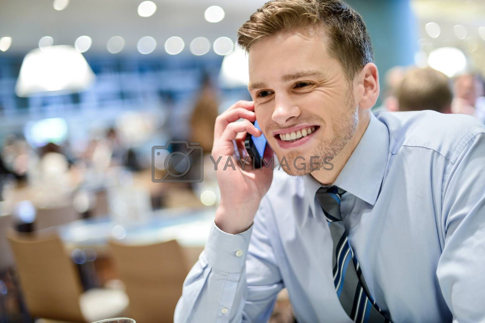 Royalty free image of Young executive talking on the phone by stockyimages