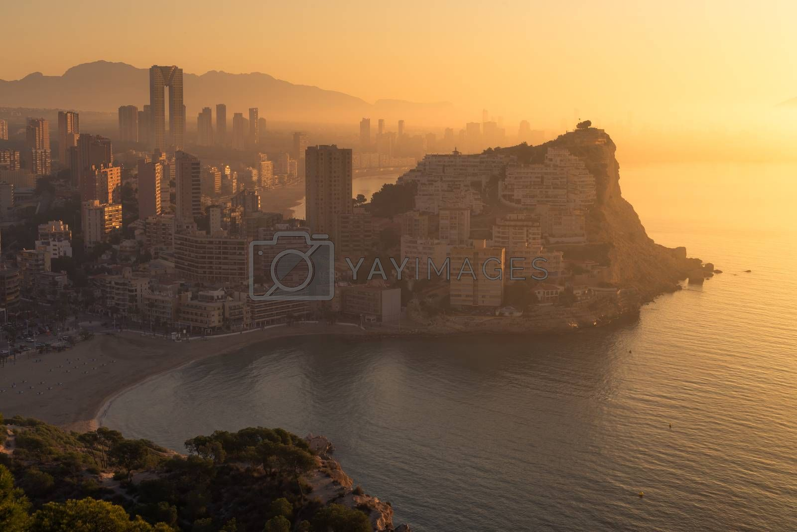 A foggy early morning casting its light on Benidorm skyline