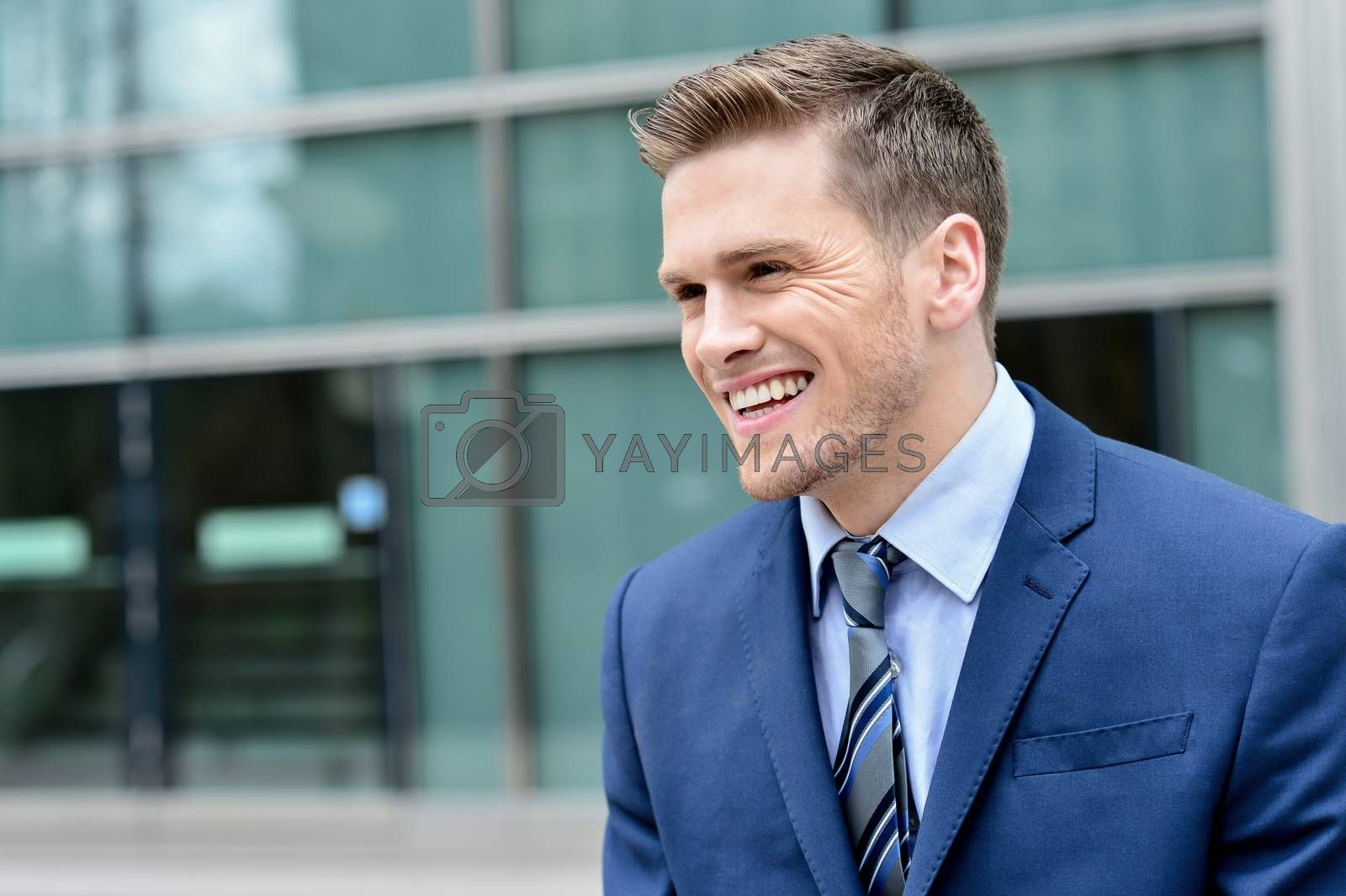 Royalty free image of Young smiling relaxed corporate guy by stockyimages