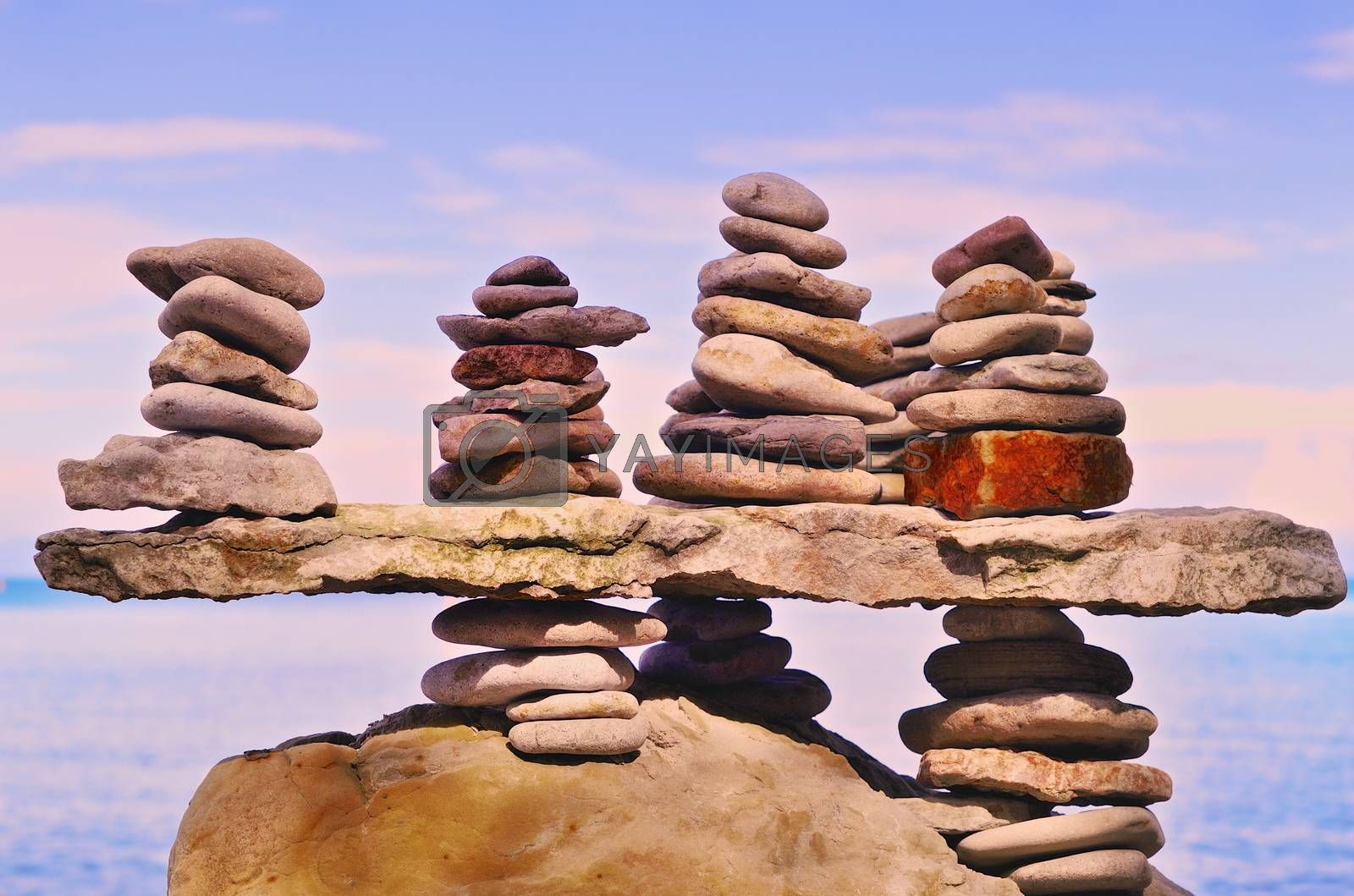 Royalty free image of Pebbles on a top of boulder by styf22