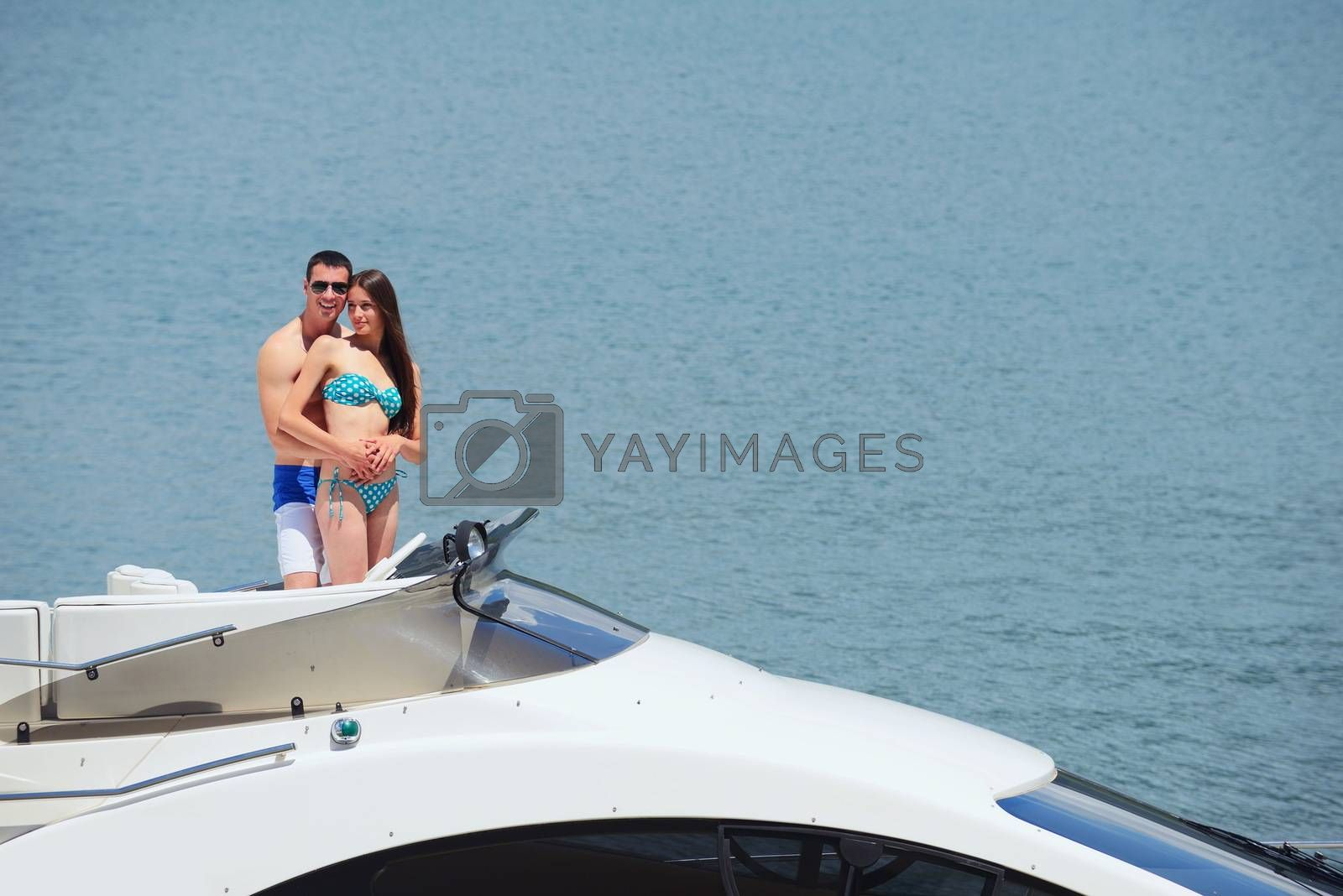Royalty free image of young couple on yacht by .shock