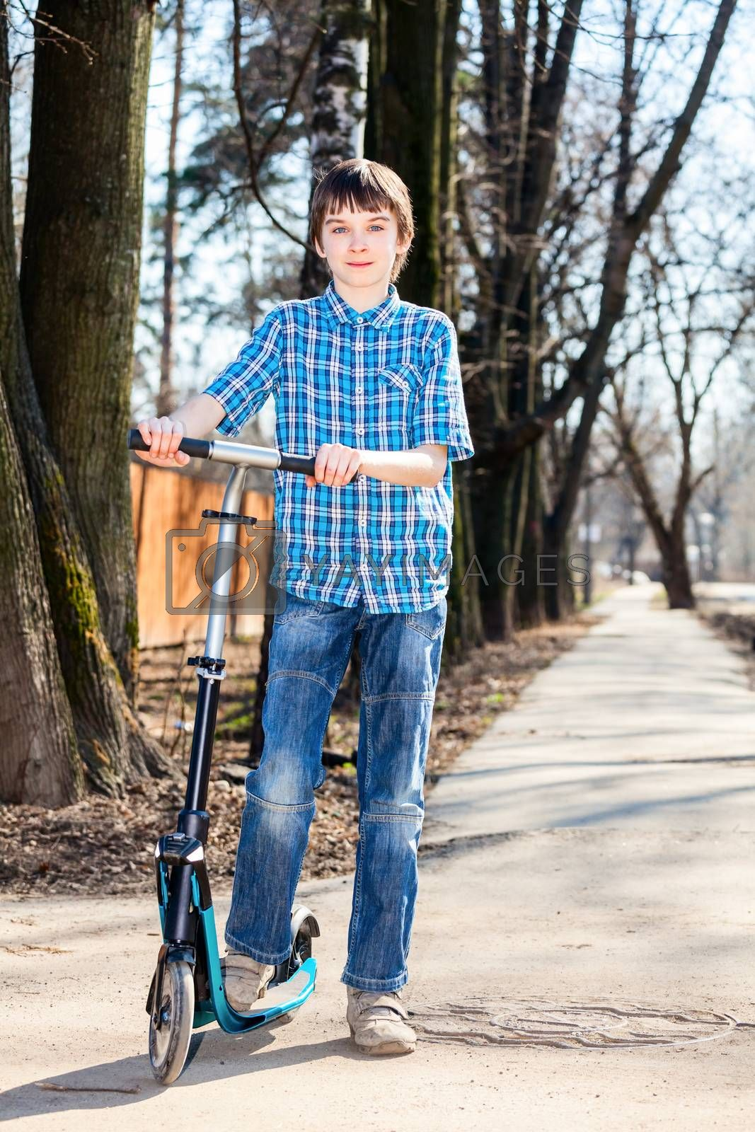 Royalty free image of Boy with kick scooter by naumoid