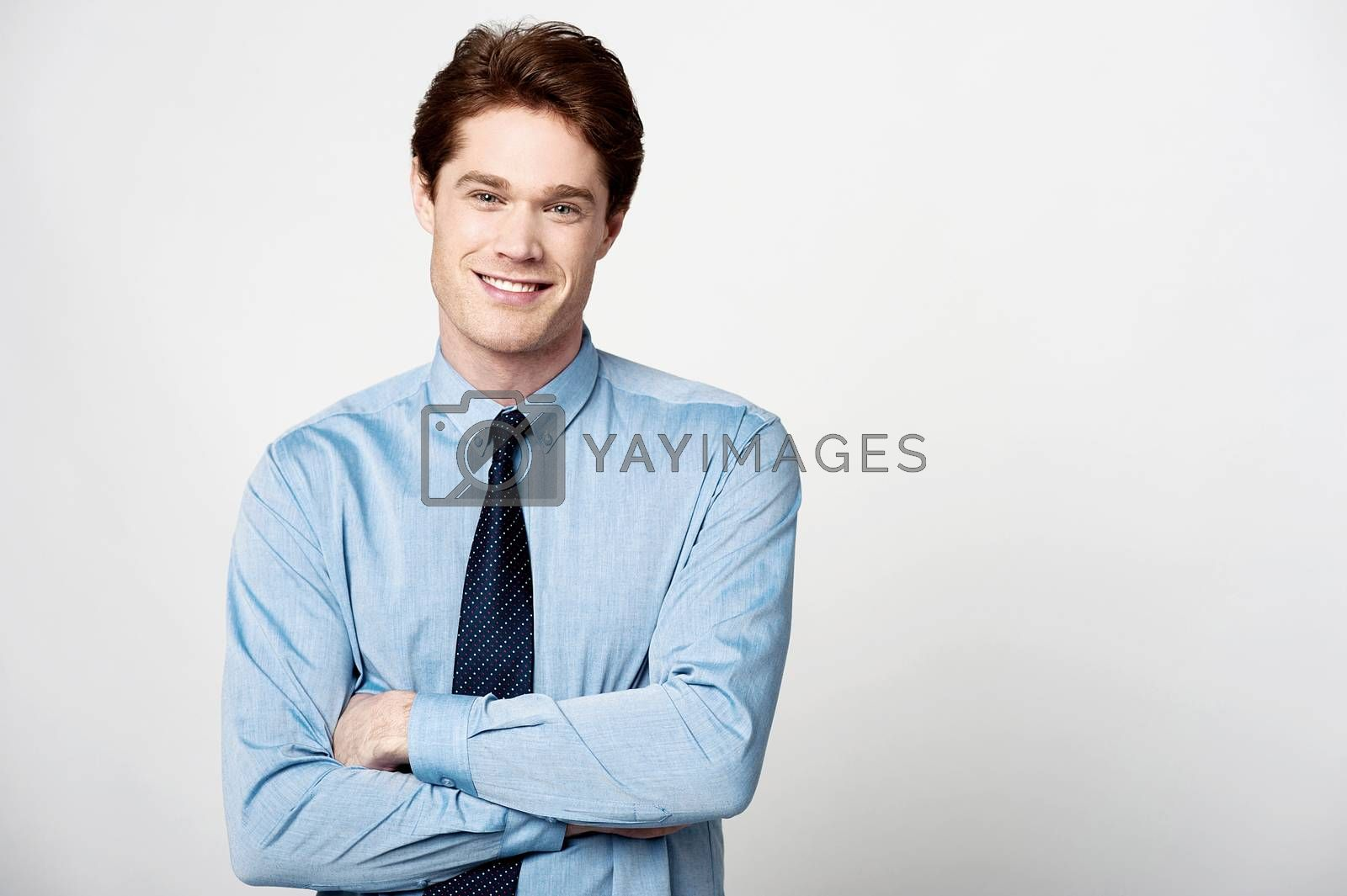 Royalty free image of Smiling businessman with folded arms by stockyimages