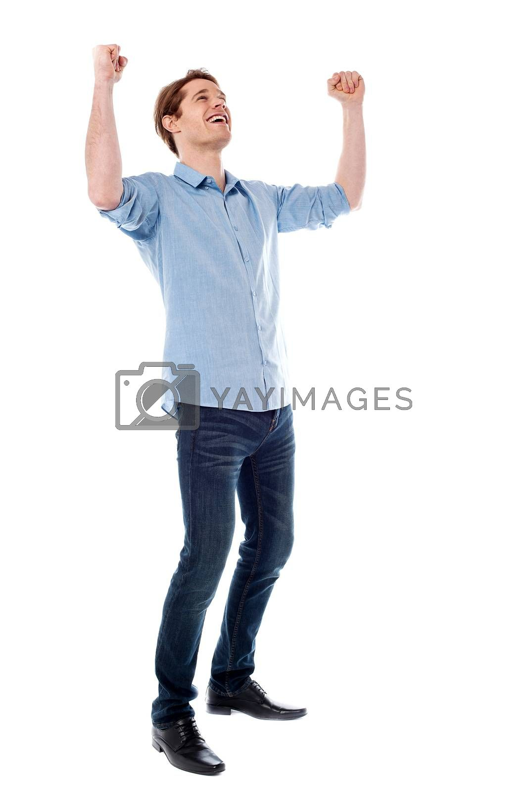 Royalty free image of Young man expressing his success by stockyimages