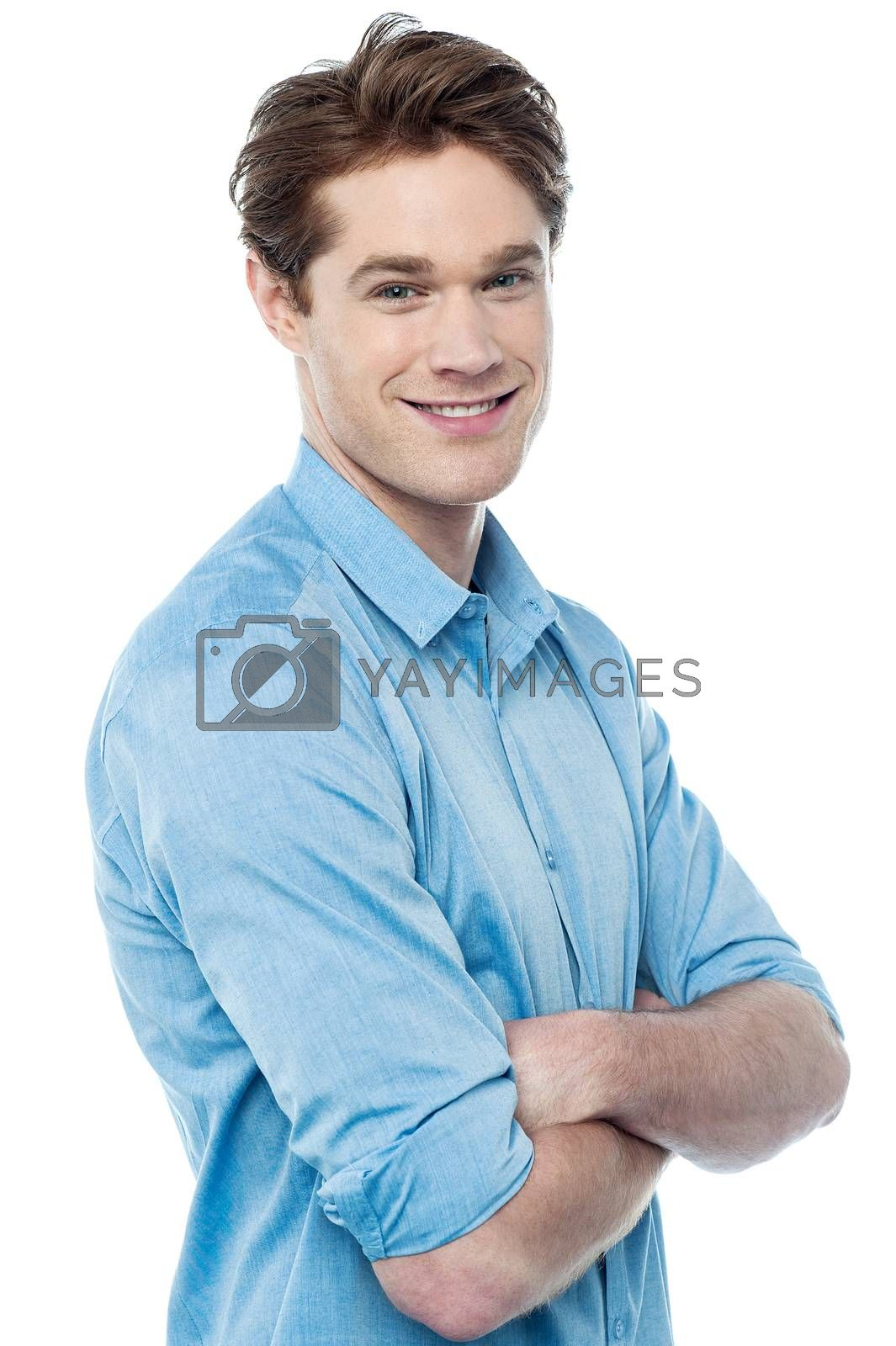 Royalty free image of Casual smiling man with arms crossed by stockyimages