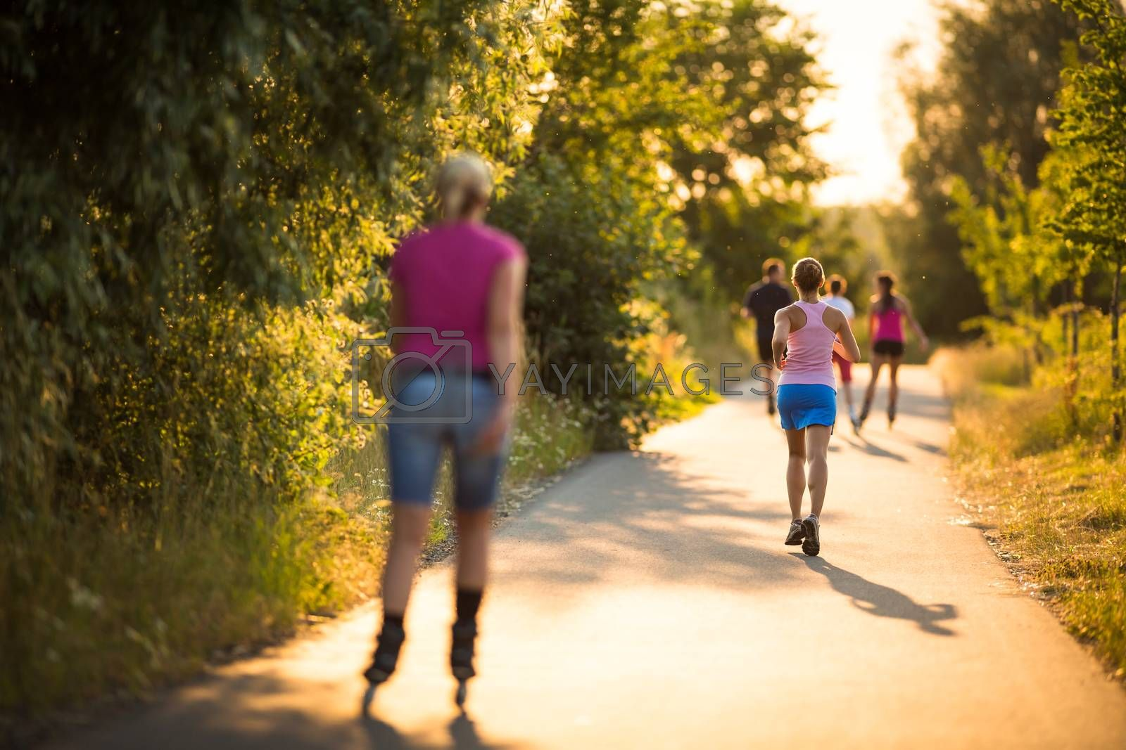 Young woman running outdoors on a lovely sunny summer evening by viktor_cap