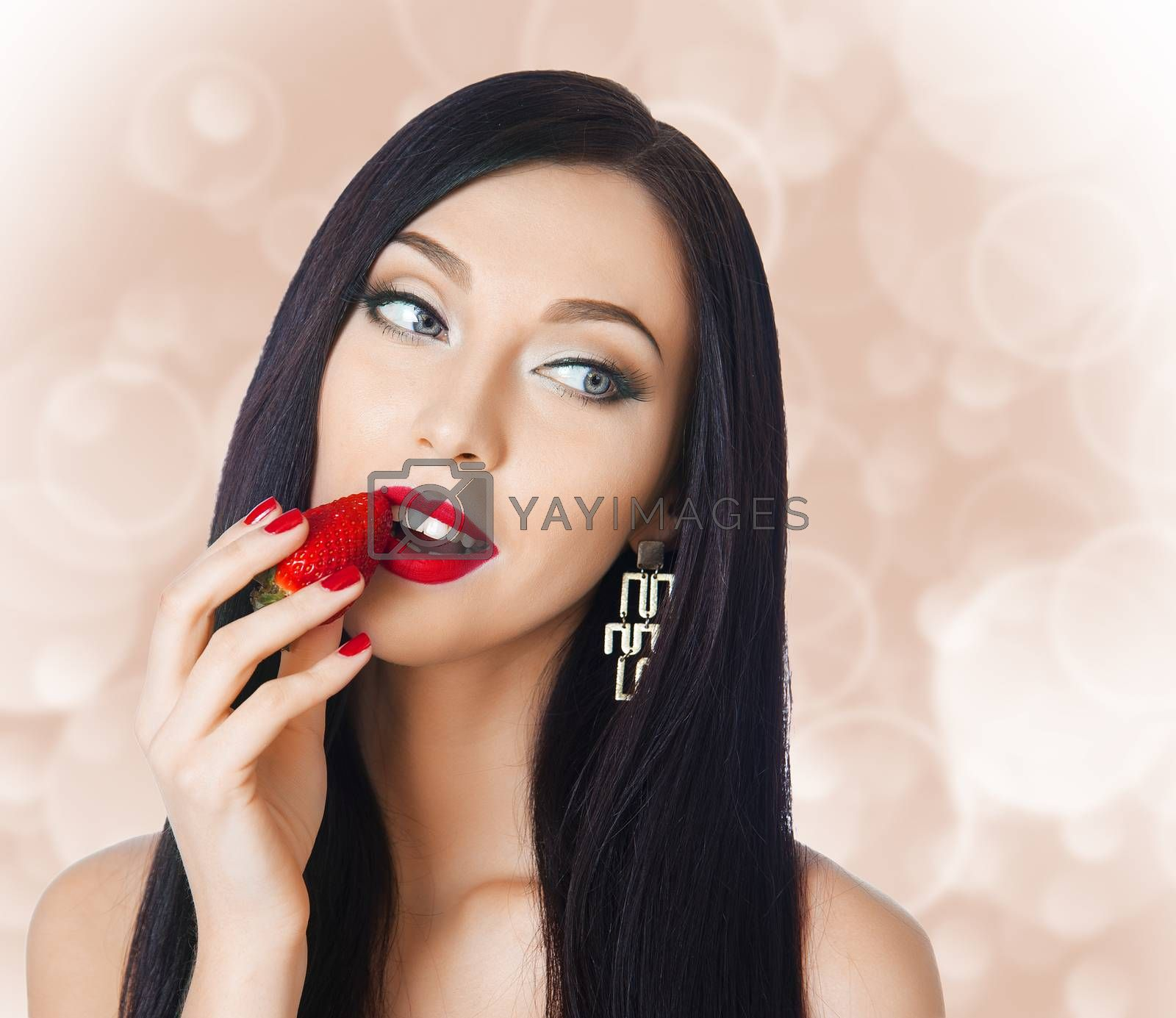 Royalty free image of woman eating strawberries by raduga21