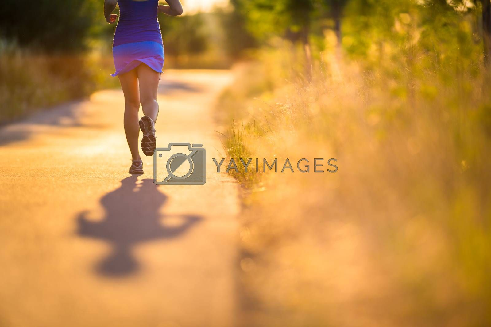 Royalty free image of Young woman running outdoors on a lovely sunny summer evening by viktor_cap