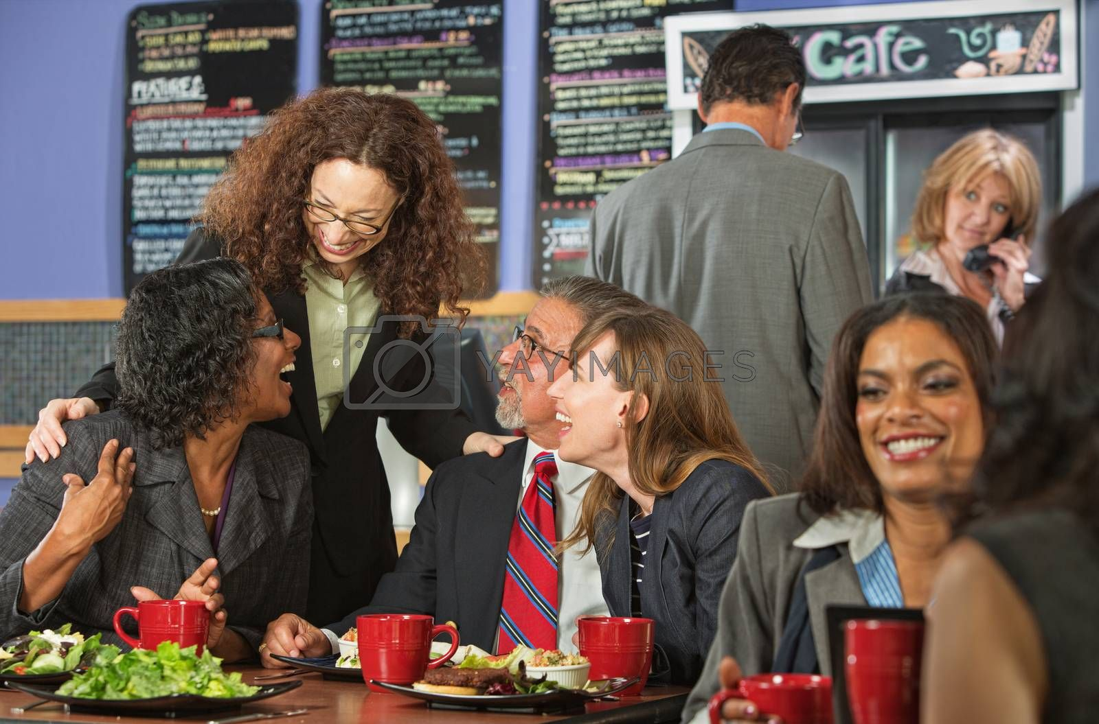 Royalty free image of Friends Joking During Lunch by Creatista