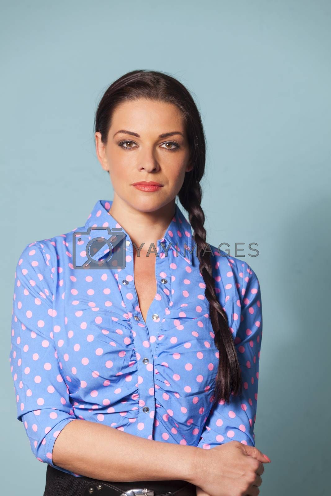 Royalty free image of woman with a dotted blouse  by bernjuer