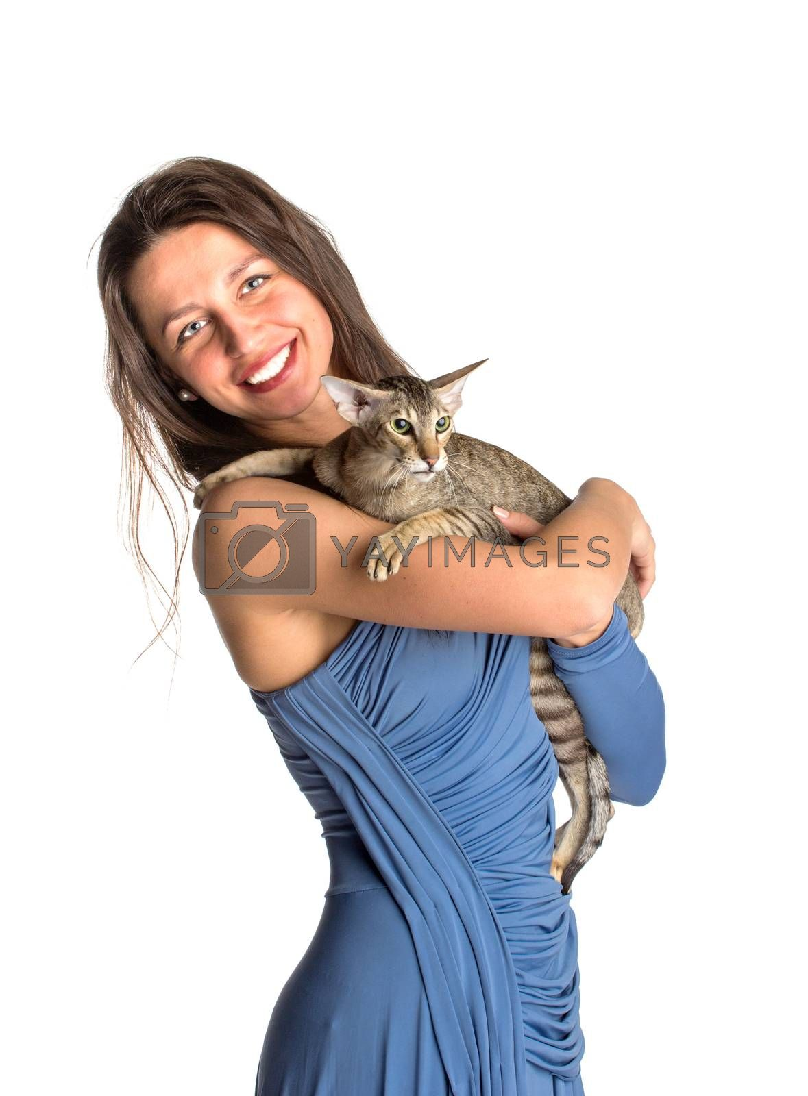 Royalty free image of Pretty girl in blue night dress with cat by gsdonlin
