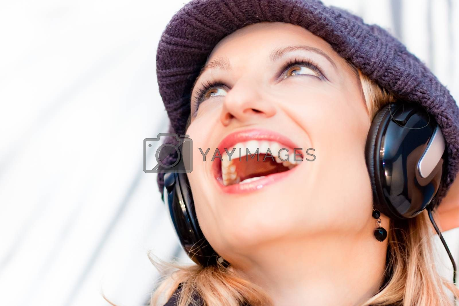 Royalty free image of Blonde lady listening to the music. by kasto
