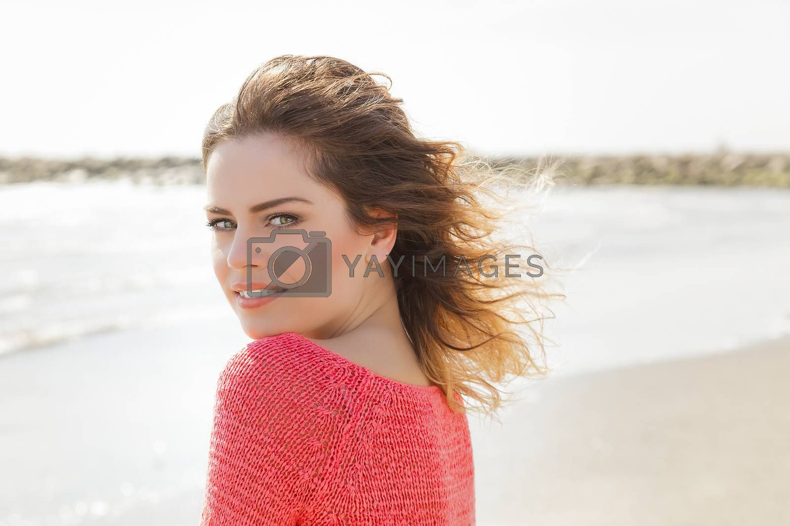 Royalty free image of Beautiful wind hair girl on the seaside by alessandroguerriero
