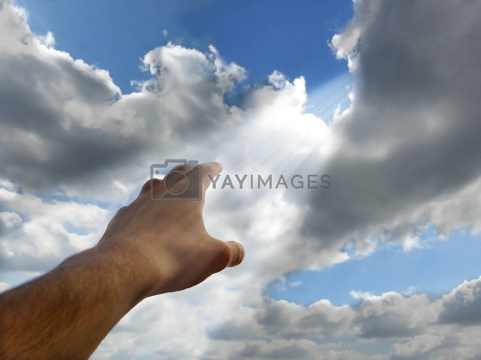 Royalty free image of Hand reaching for the sky by fjanecic