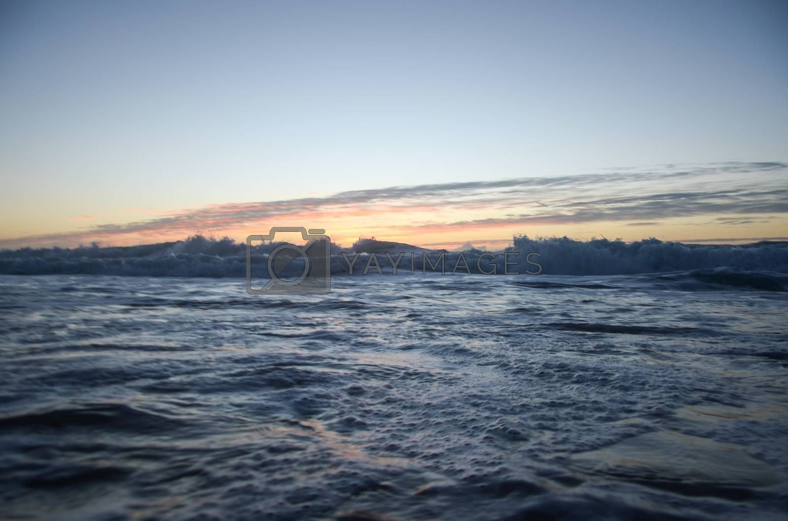 Royalty free image of Sea under sunset by afonsoasneves