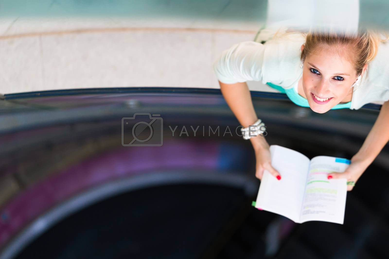 Royalty free image of On campus - pretty, female student by viktor_cap