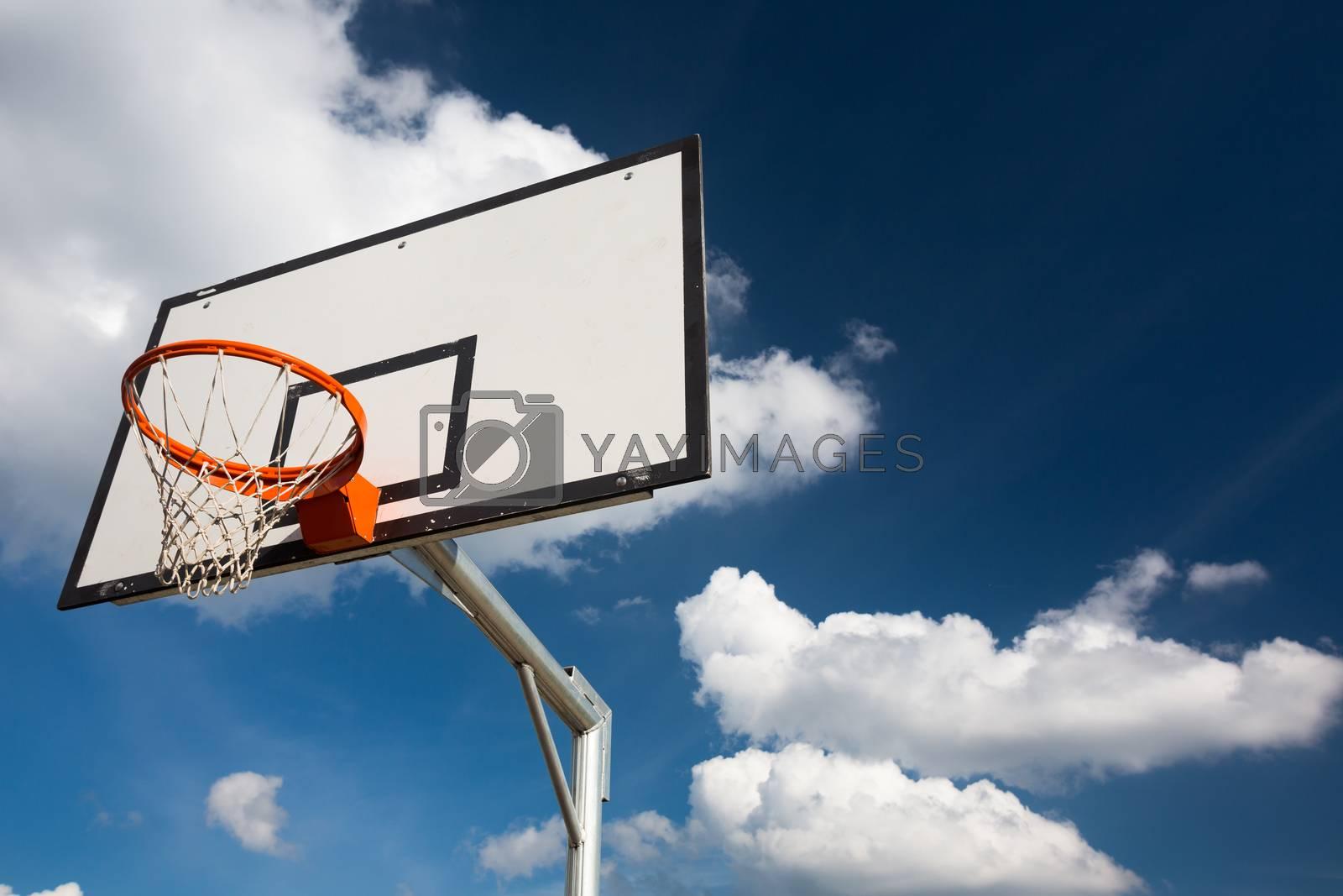 Royalty free image of Basketball hoop against  lovely blue summer sky by viktor_cap