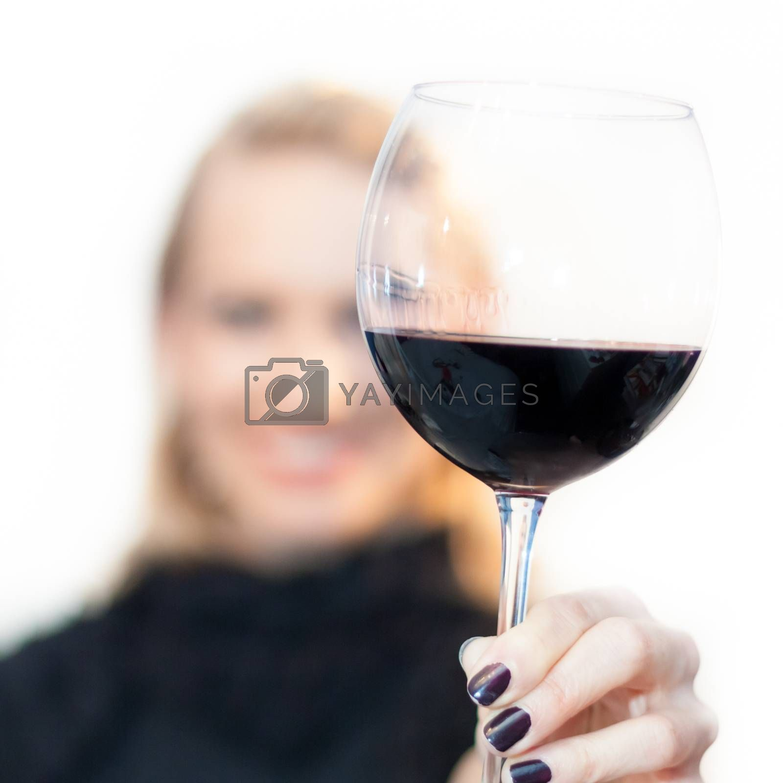 Royalty free image of Toasting with a glass of red wine. by kasto