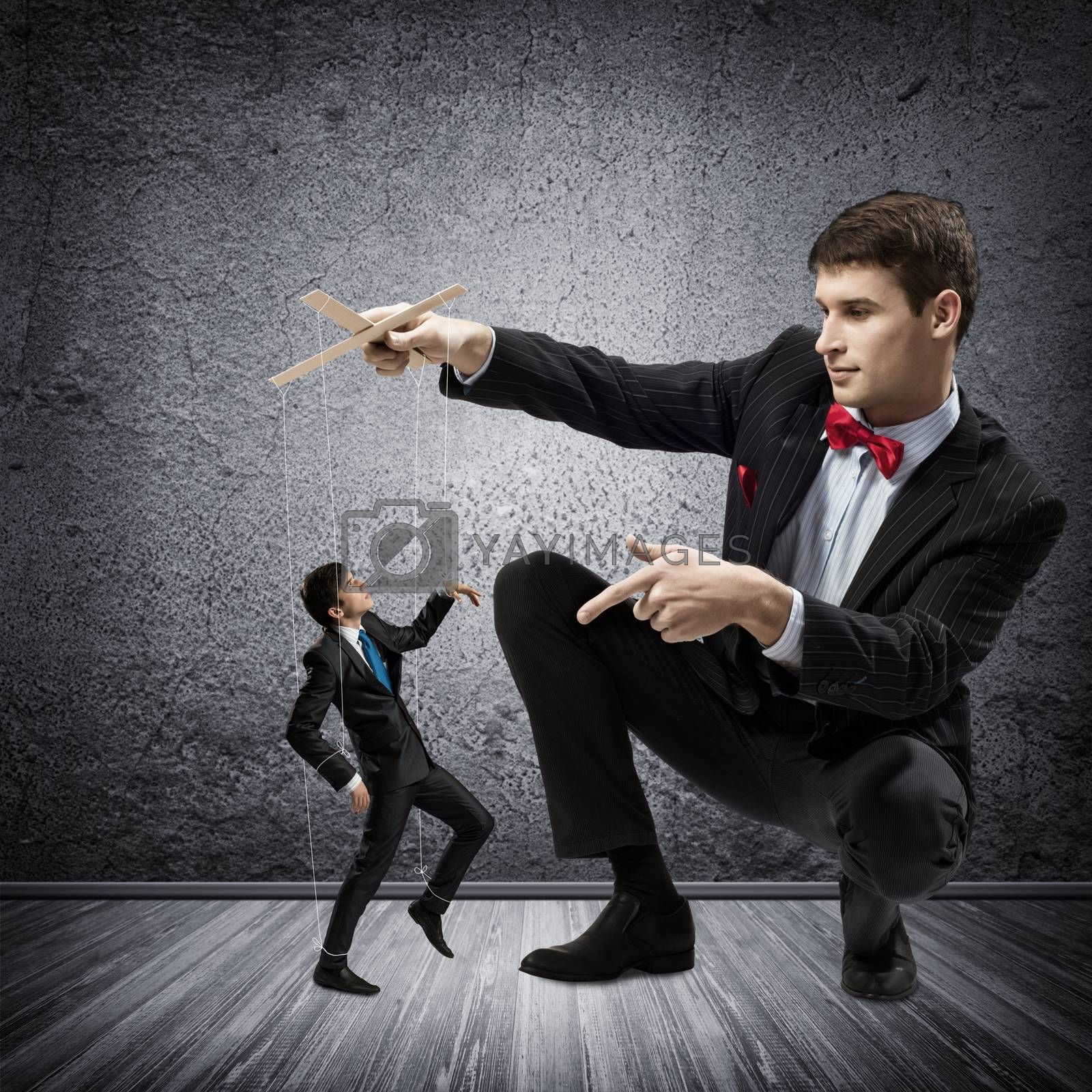 Royalty free image of puppeteer and puppet business by adam121