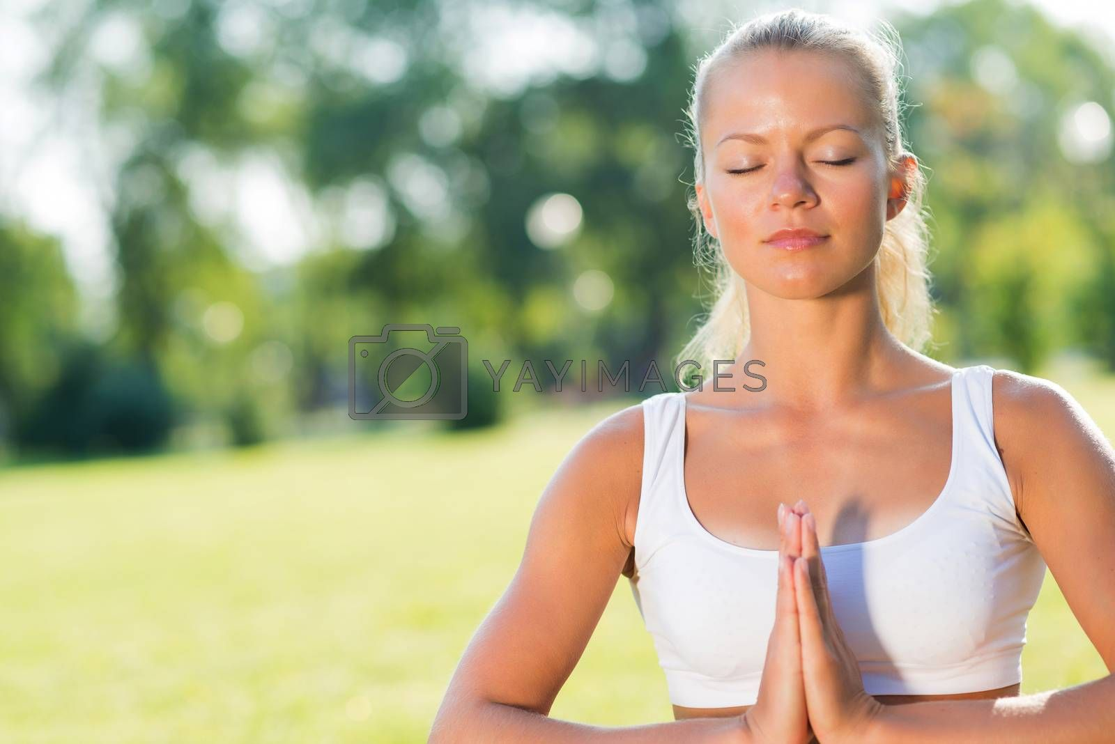 Royalty free image of woman doing yoga in the park by adam121