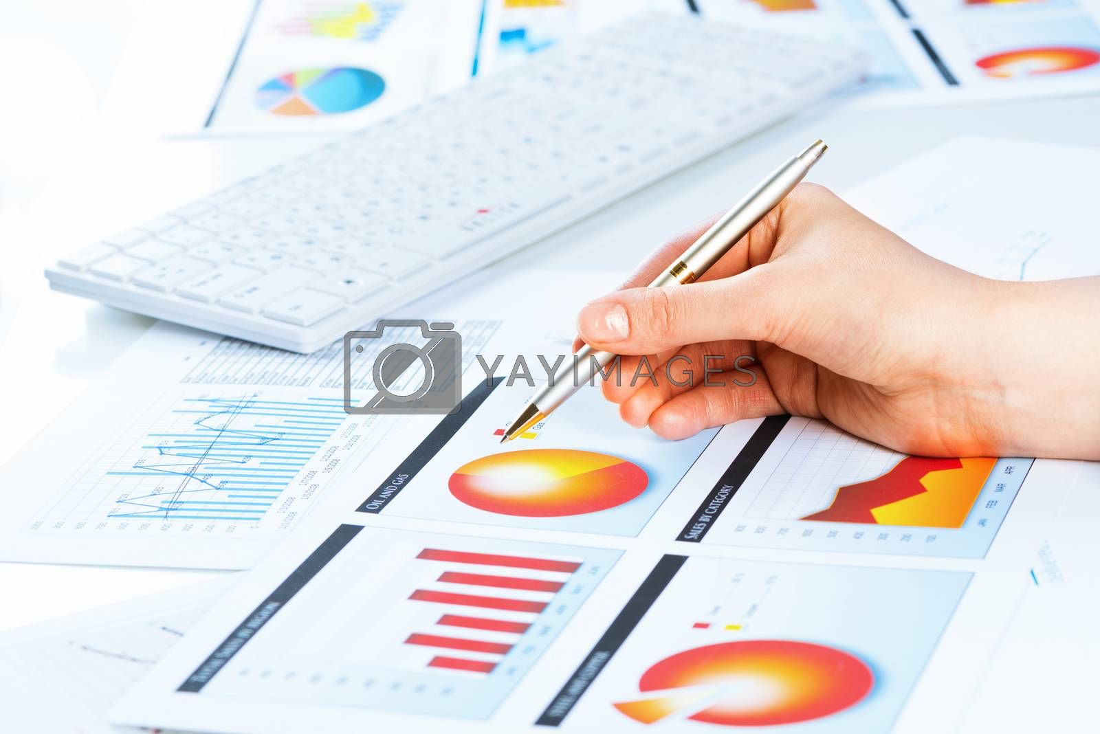 Royalty free image of female hand pointing to the financial growth chart by adam121