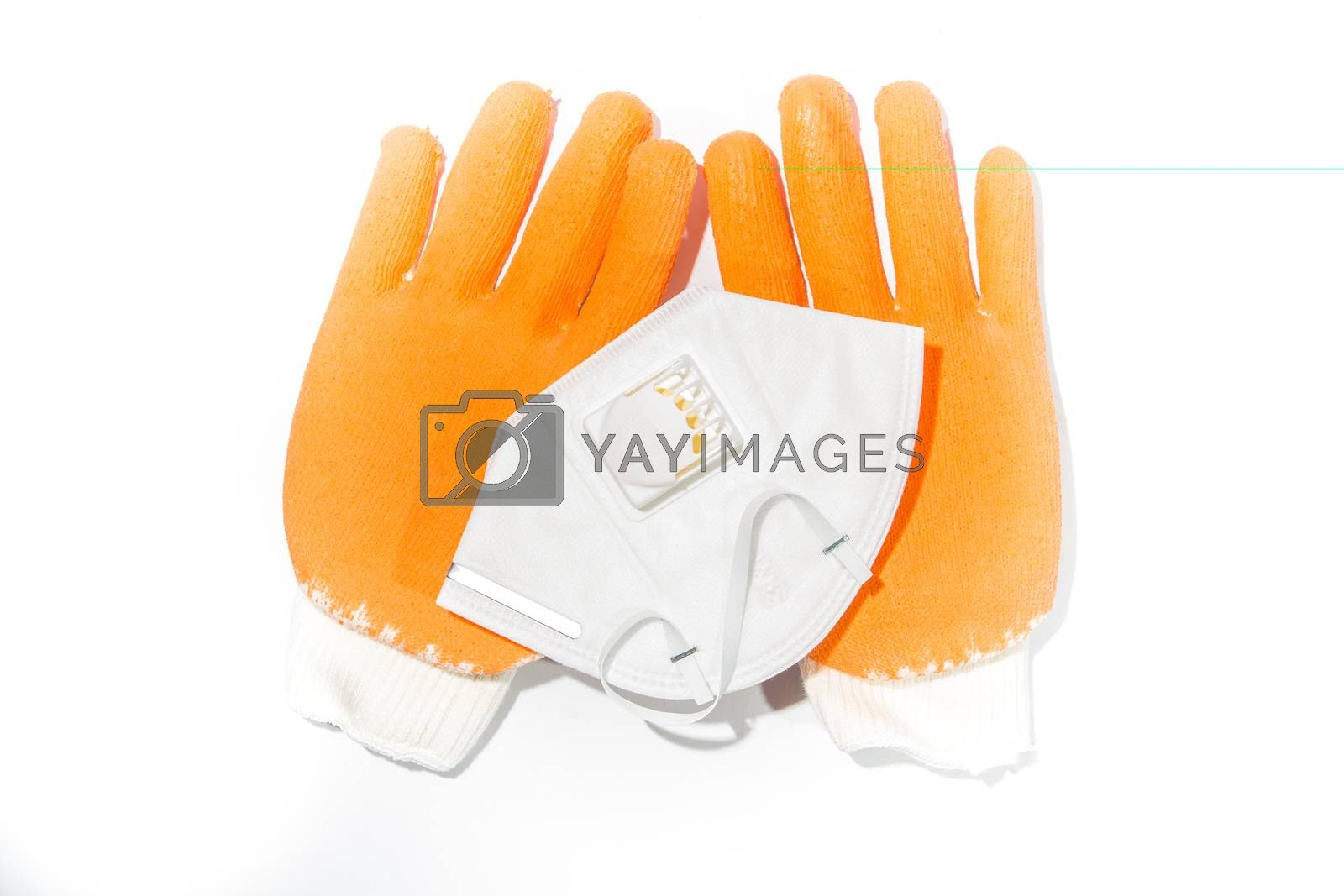 Royalty free image of Gloves and a dust mask by tuchkay