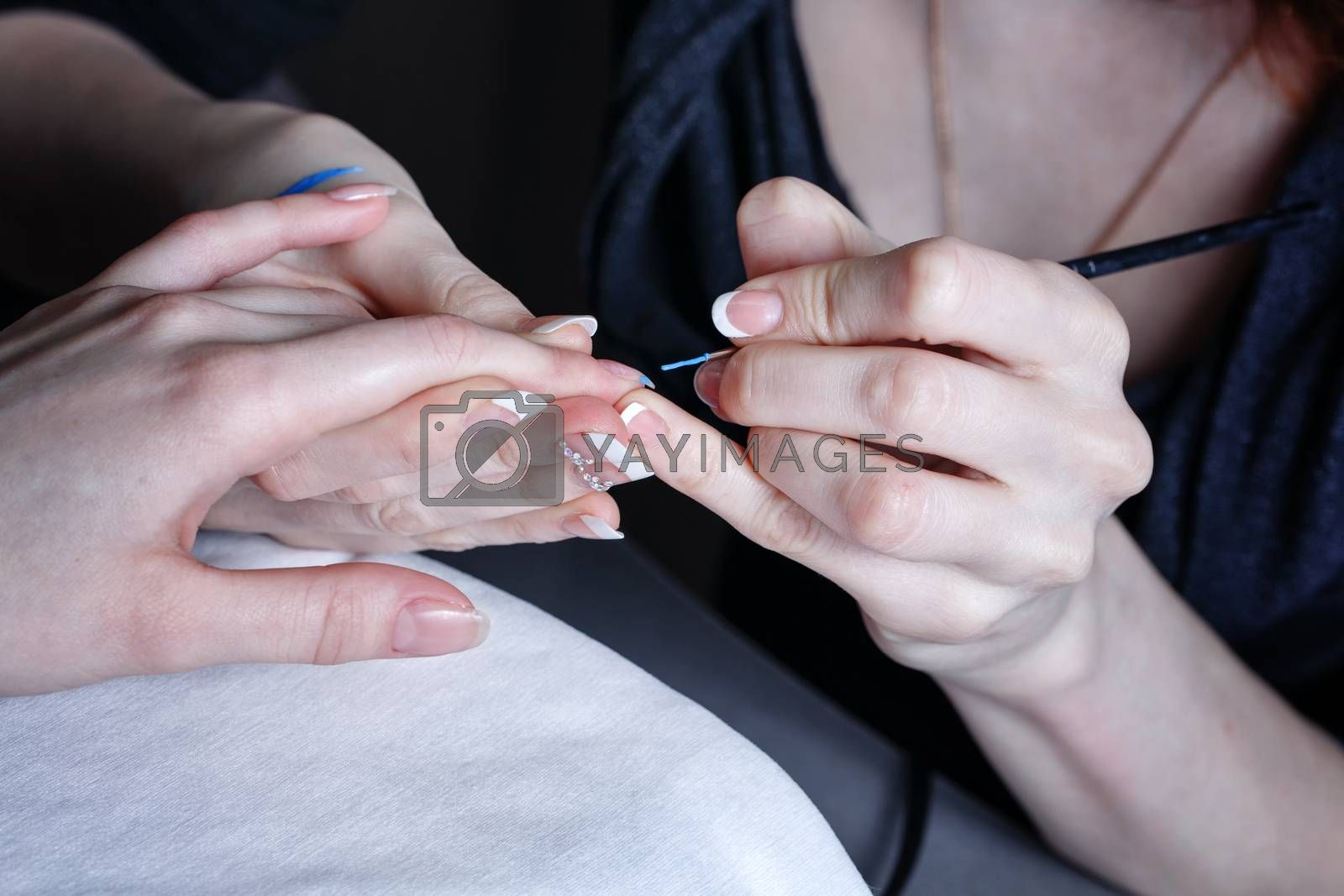 Royalty free image of Creation manicure by Vagengeym
