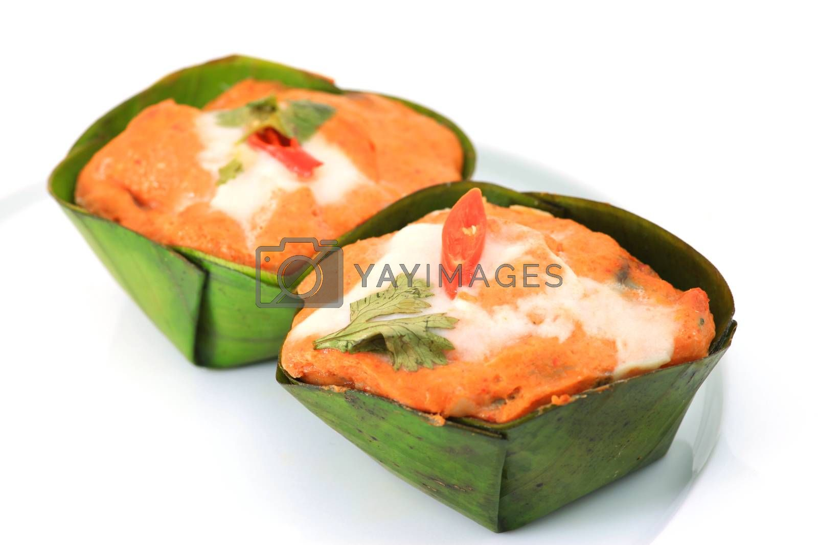 Royalty free image of steamed fish with curry paste by antpkr
