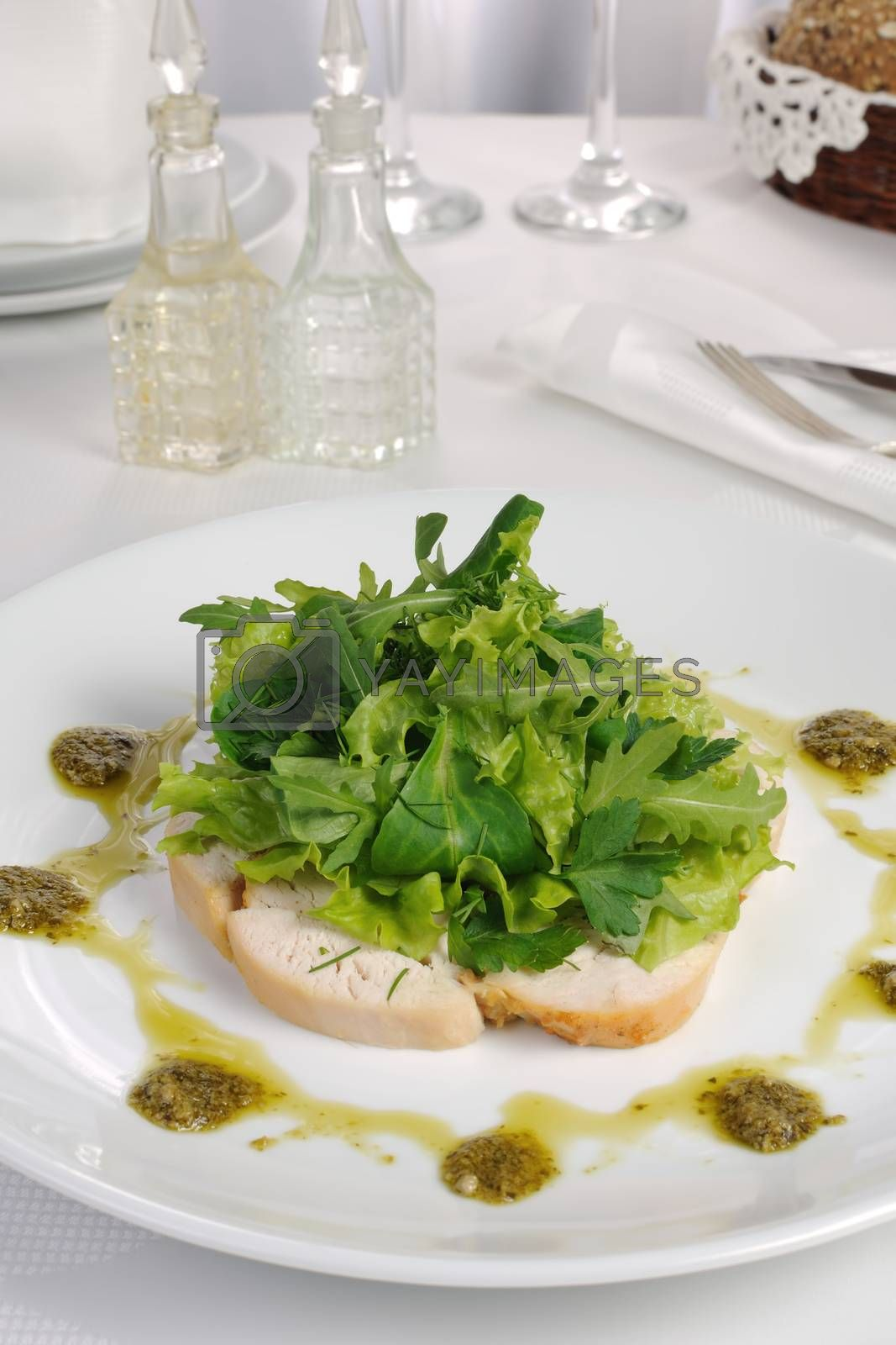 Slices of roasted chicken with lettuce by Apolonia