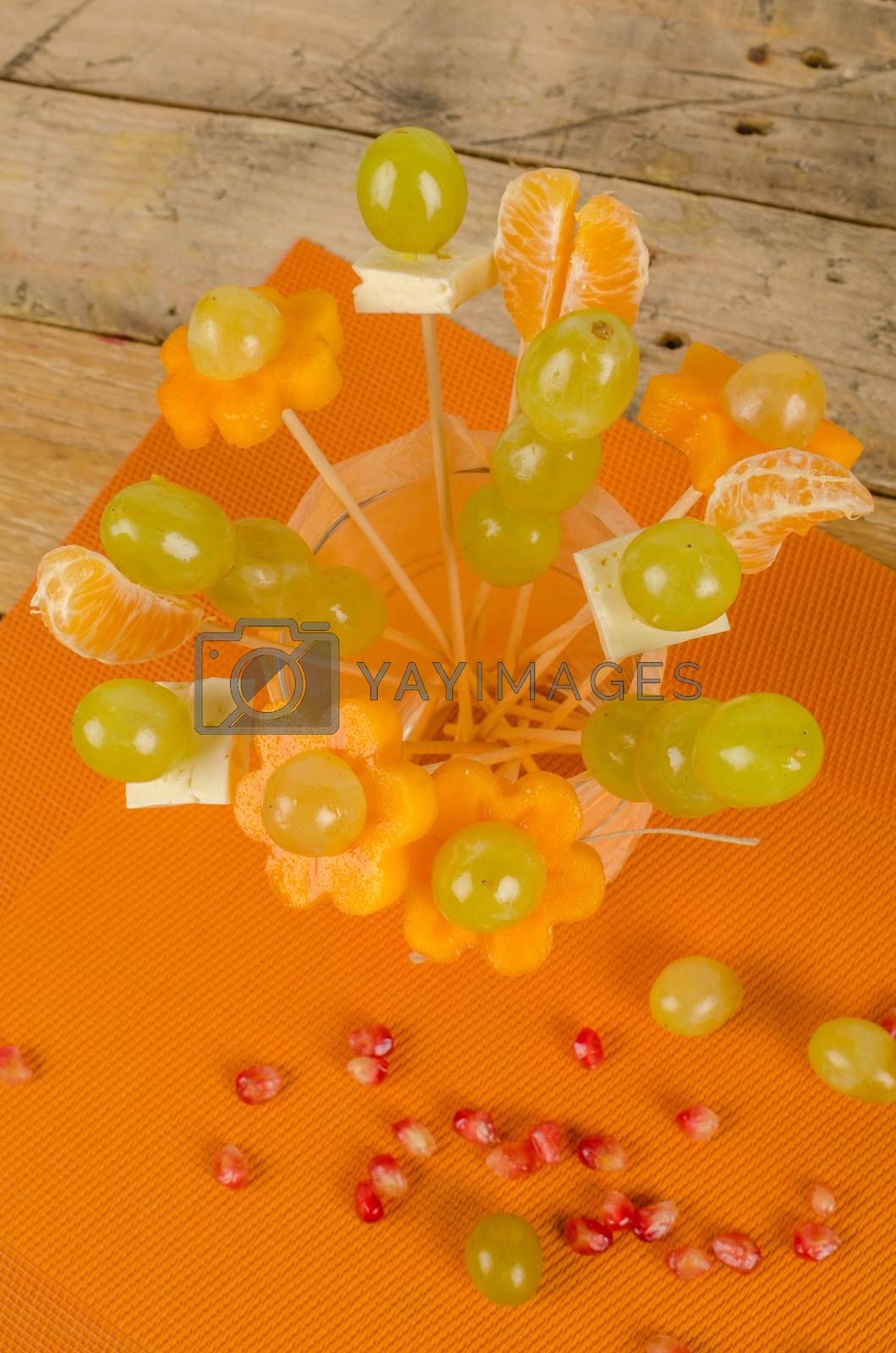 Fruit cocktail  on skewers inside a glass, kid food