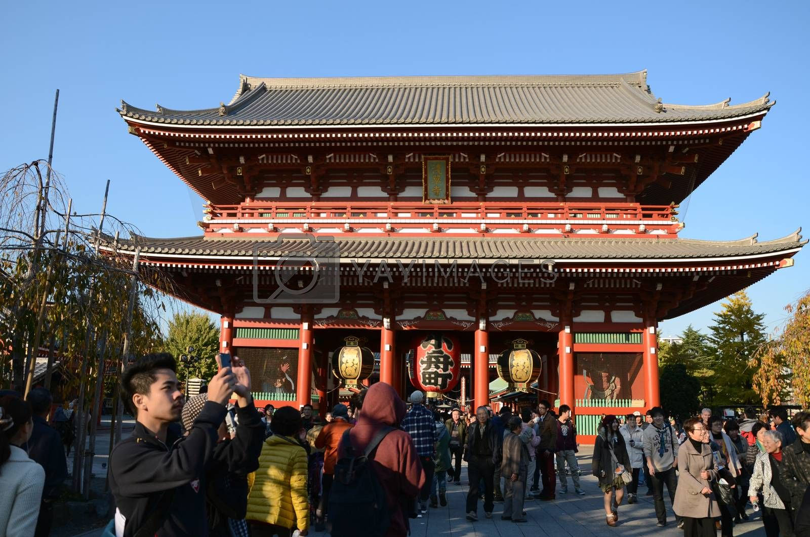 TOKYO, JAPAN - NOV 21: The Buddhist Temple Senso-ji is the symbol of Asakusa and attracting thousands of tourists on November 21, 2013 in Tokyo, Japan.