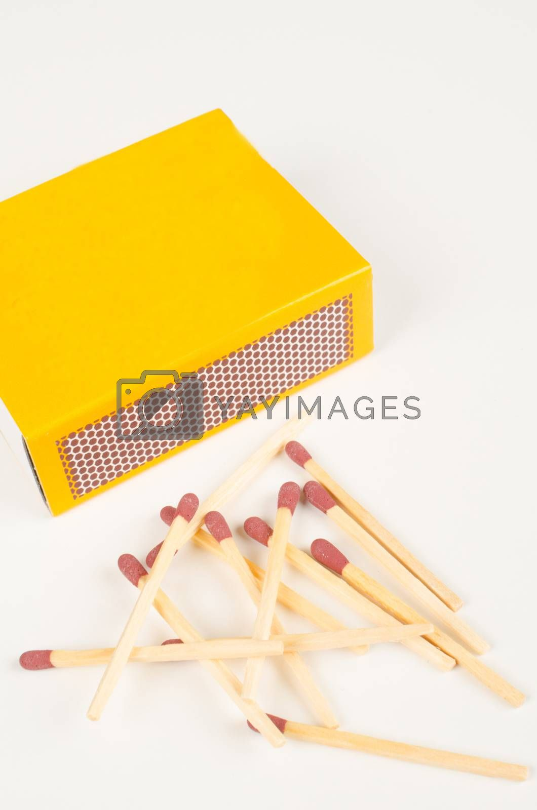 Wooden matches, matchbox and its striking surface