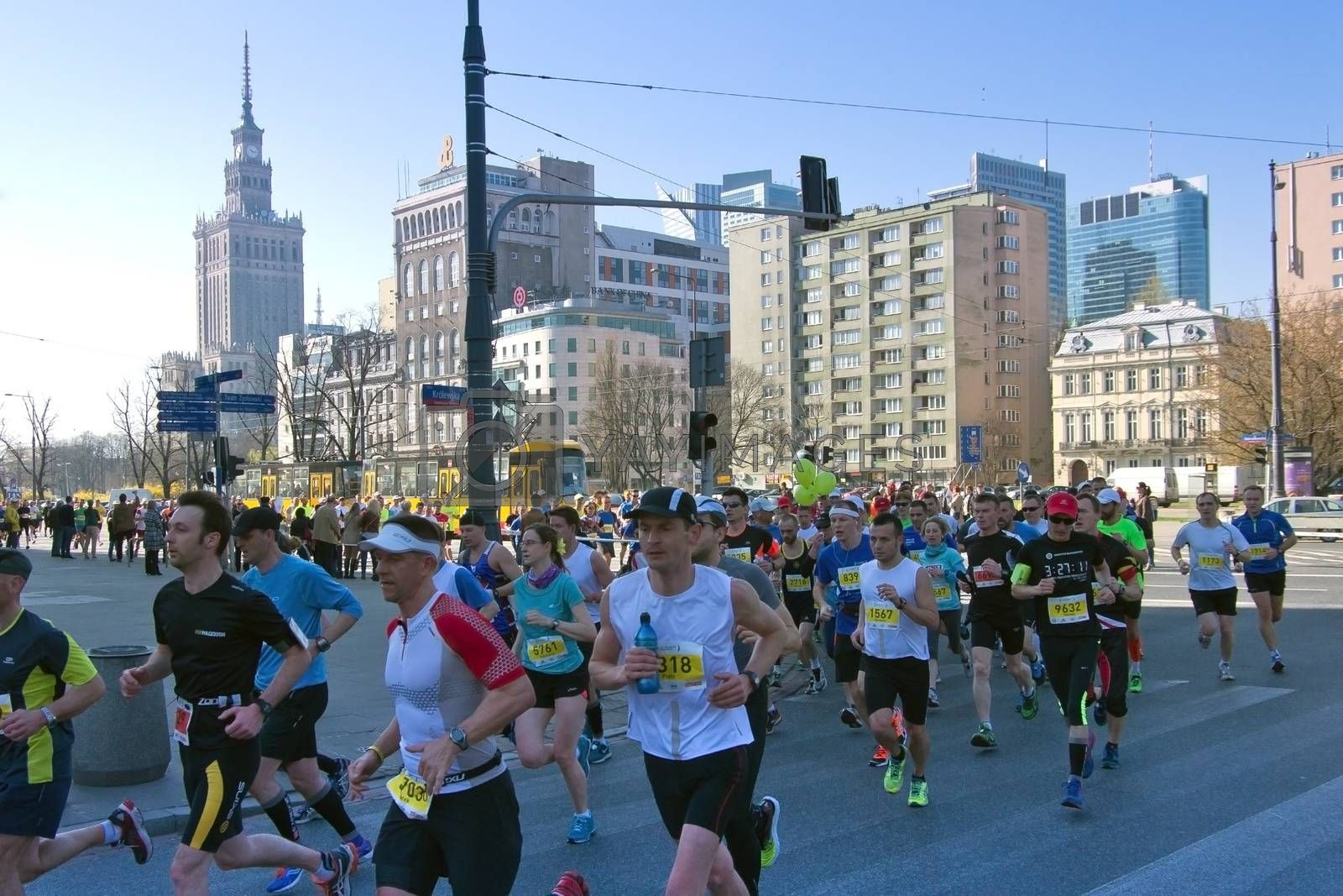 Warsaw, Poland – March  30, 2014: Participants of the 9th Warsaw Half Marathon in the city center