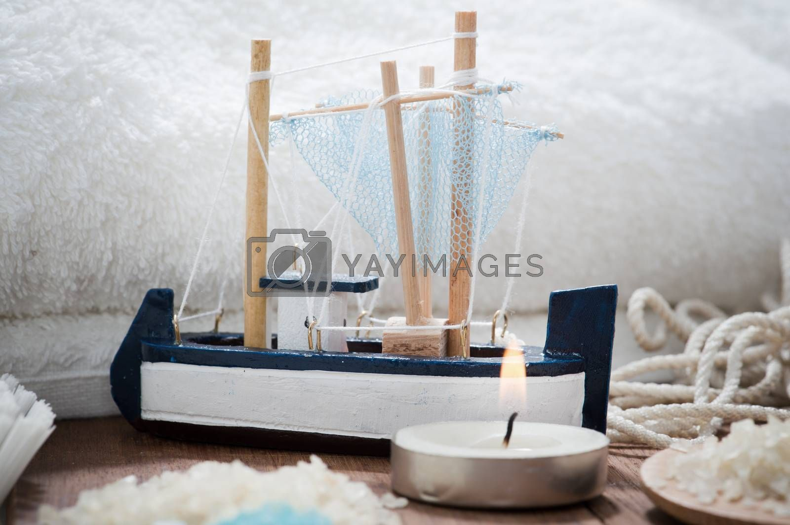 Bathroom Spa Set on wooden table with salt and candle