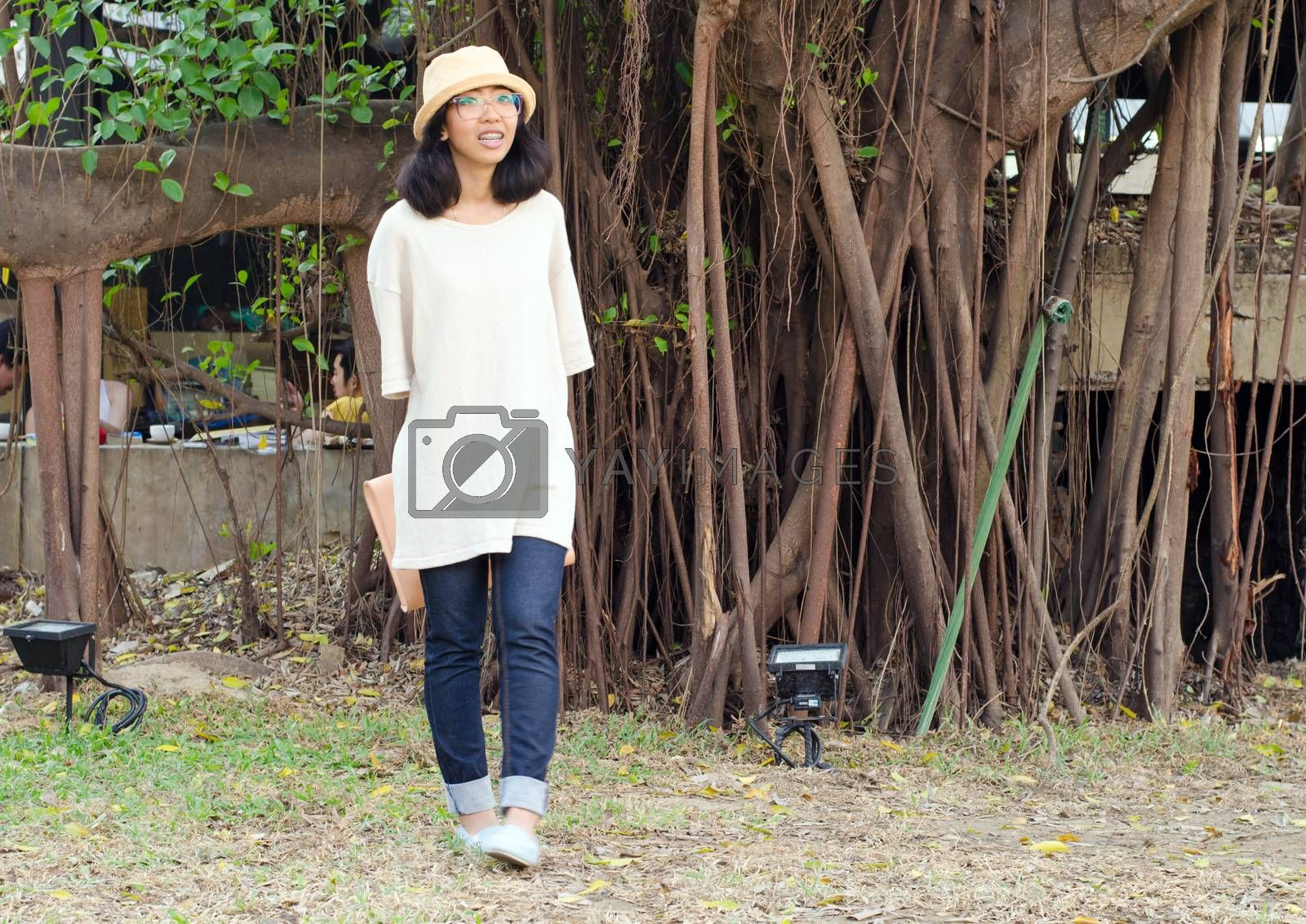Young fashion girl with handbag on nature background