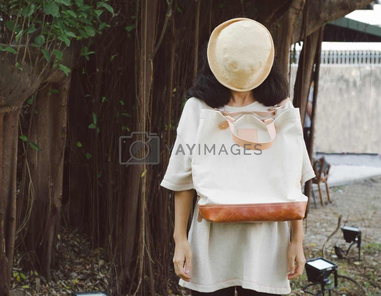 Young woman with a canvas bag, Outdoor portrait
