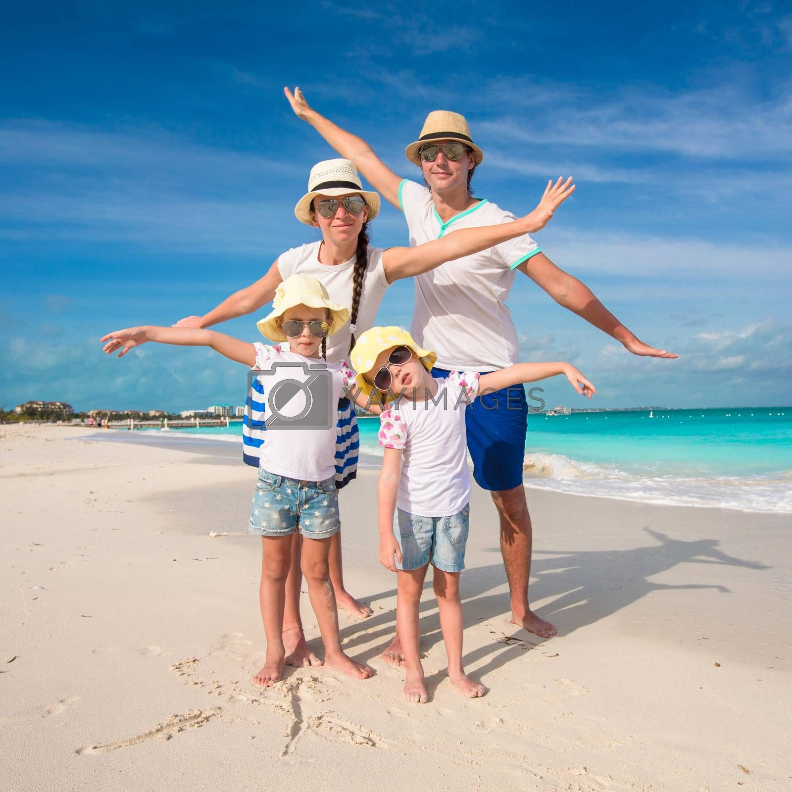 Family of four on caribbean beach vacation
