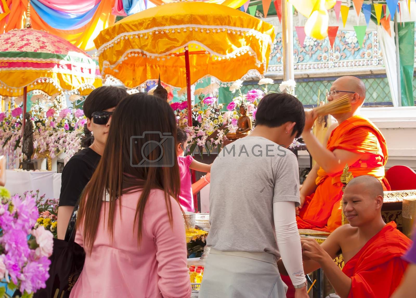 BANGKOK-APRIL 16:Unidentified monk pouring a holy water to people for a good luck in Songkran festival tradition of thailand.  April 16,2014 in Bangkok ,Thailand