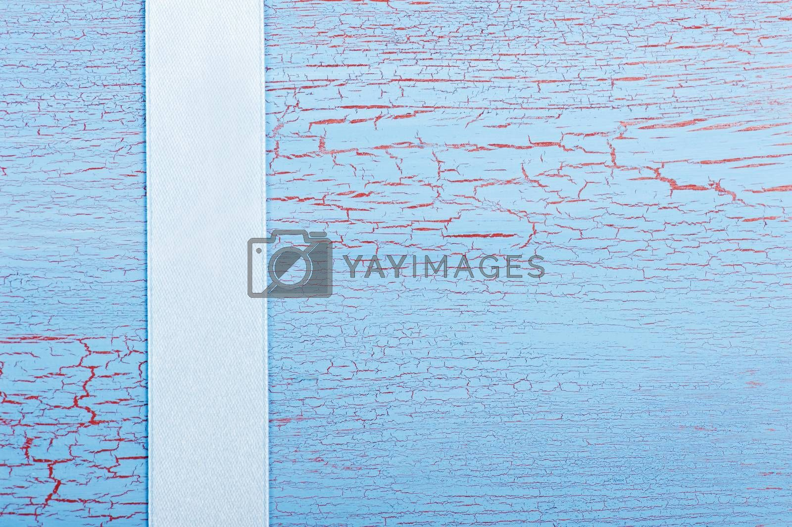 Blue ribbon on shabby blue red background
