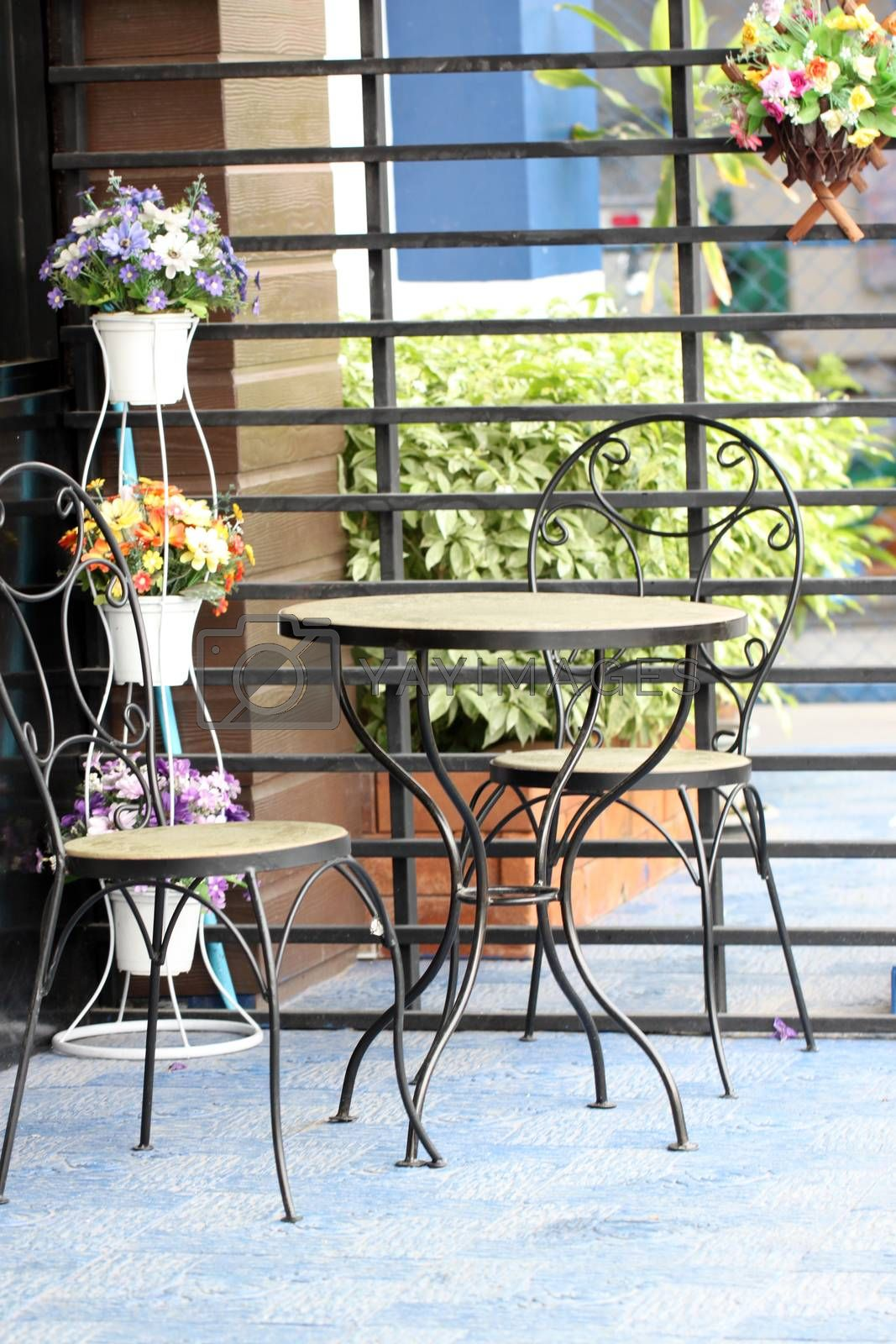 The table decorated with colorful flower pots in the corner. by meepoohyaphoto