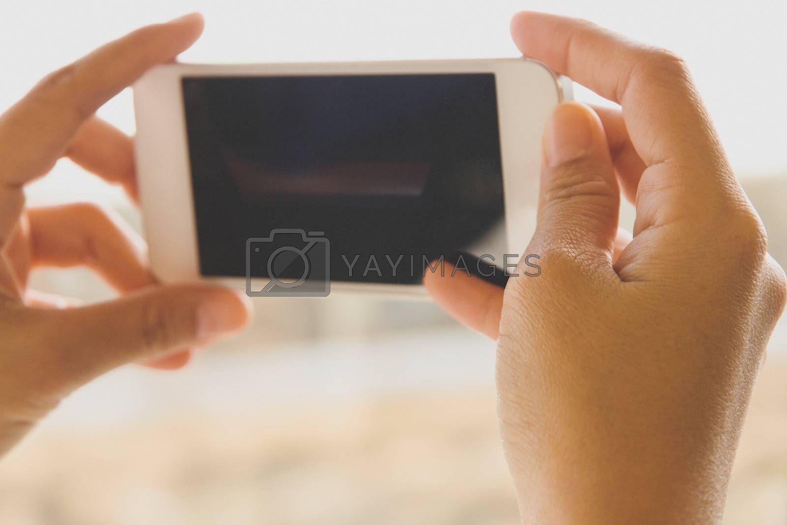 Woman Using a Smart Phone by ponsulak