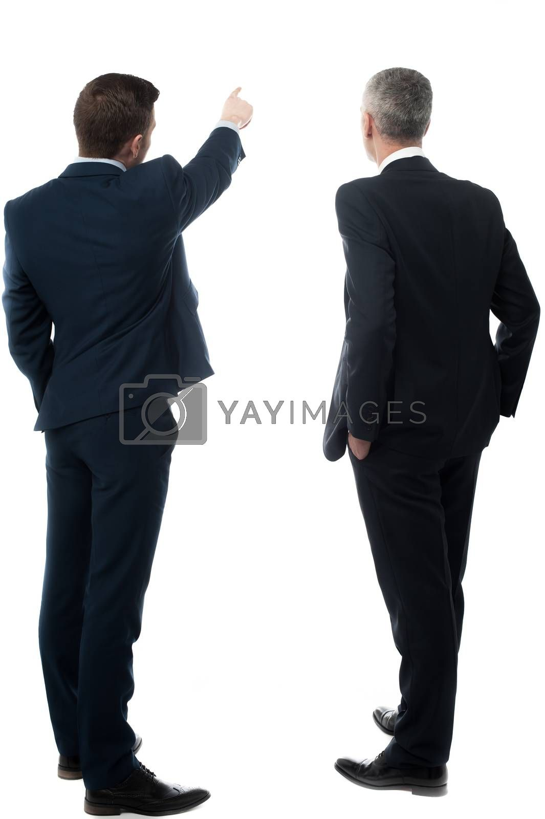 Rear-view image of two businessmen by stockyimages