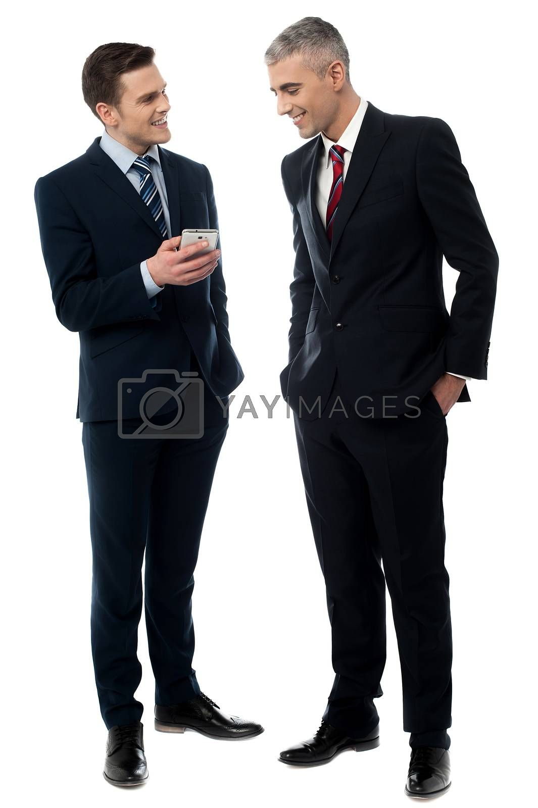 Businessmen using mobile phone by stockyimages