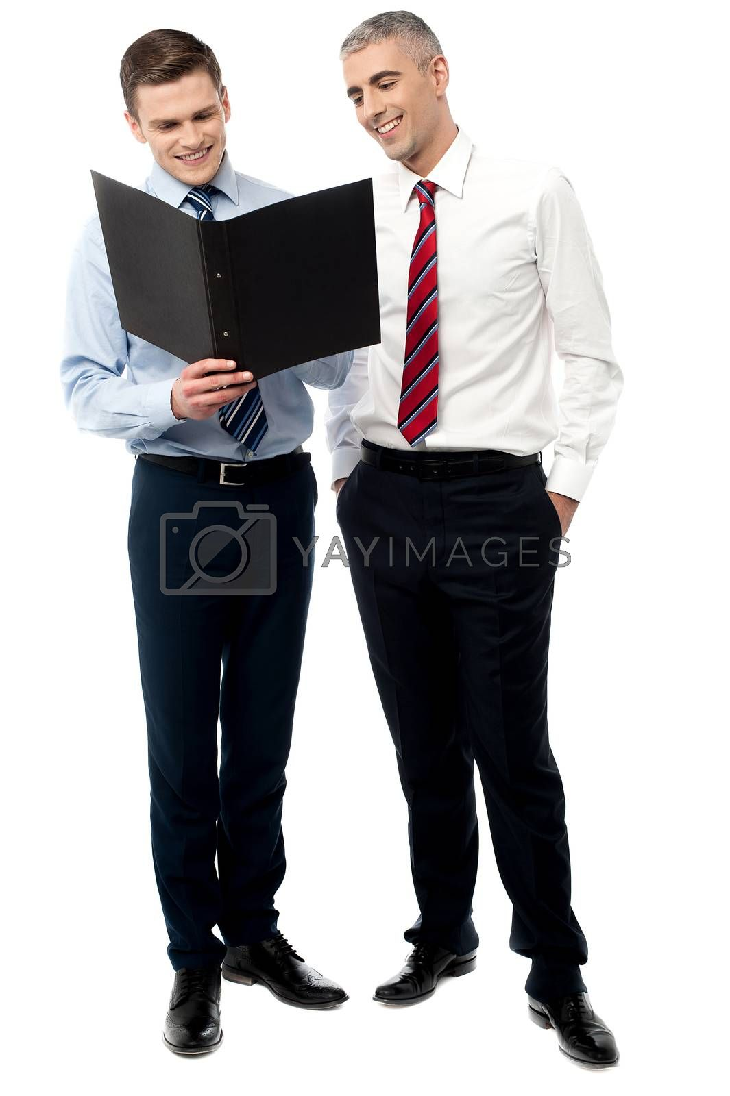 Two businessmen discussing isolated on white by stockyimages